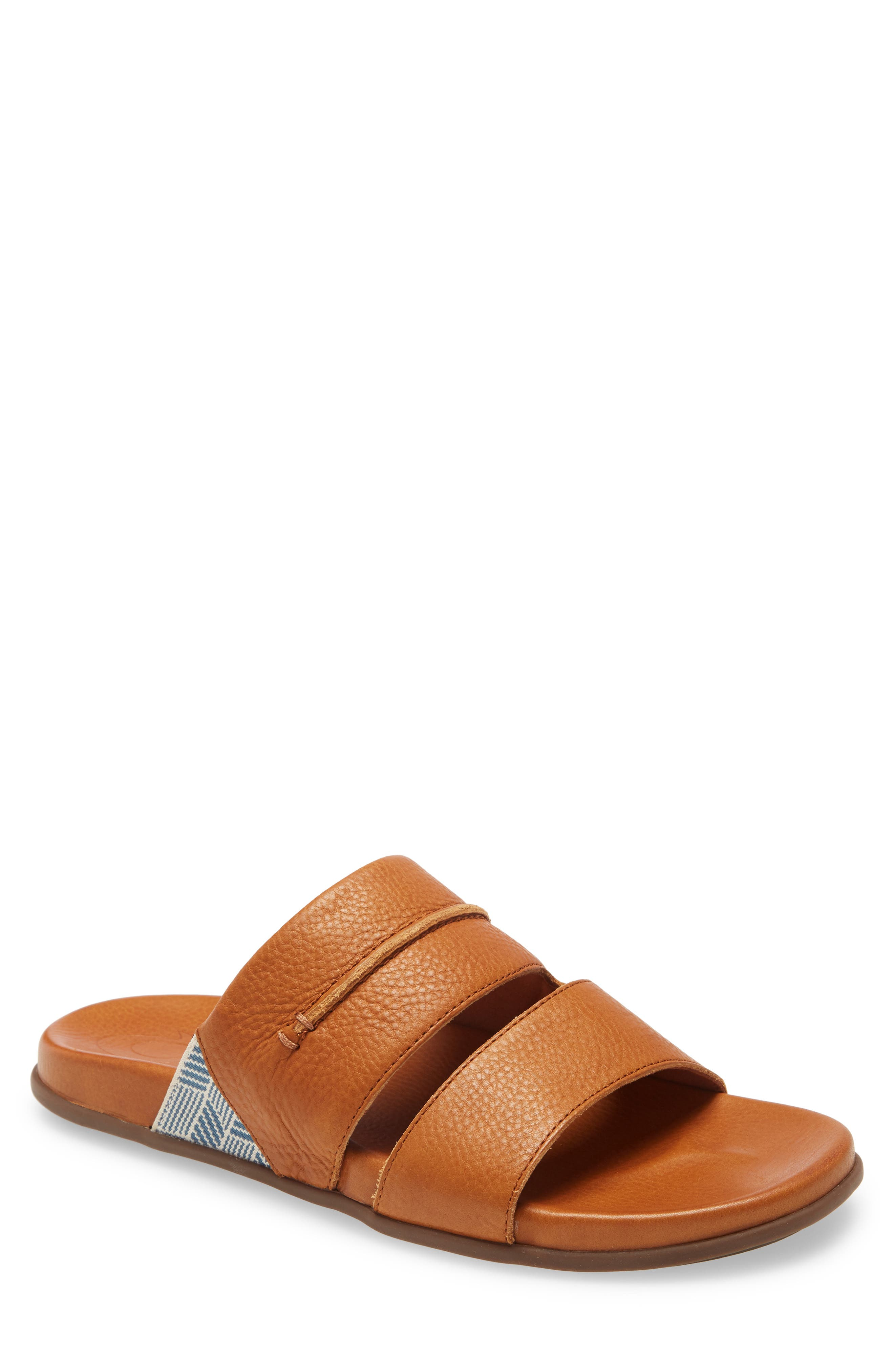 Full-grain, vegetable-tanned Italian leather elevates a laid-back sandal with an anatomical footbed for superior comfort. Style Name: Olukai Malino Olu Slide Sandal (Men). Style Number: 6027842. Available in stores.