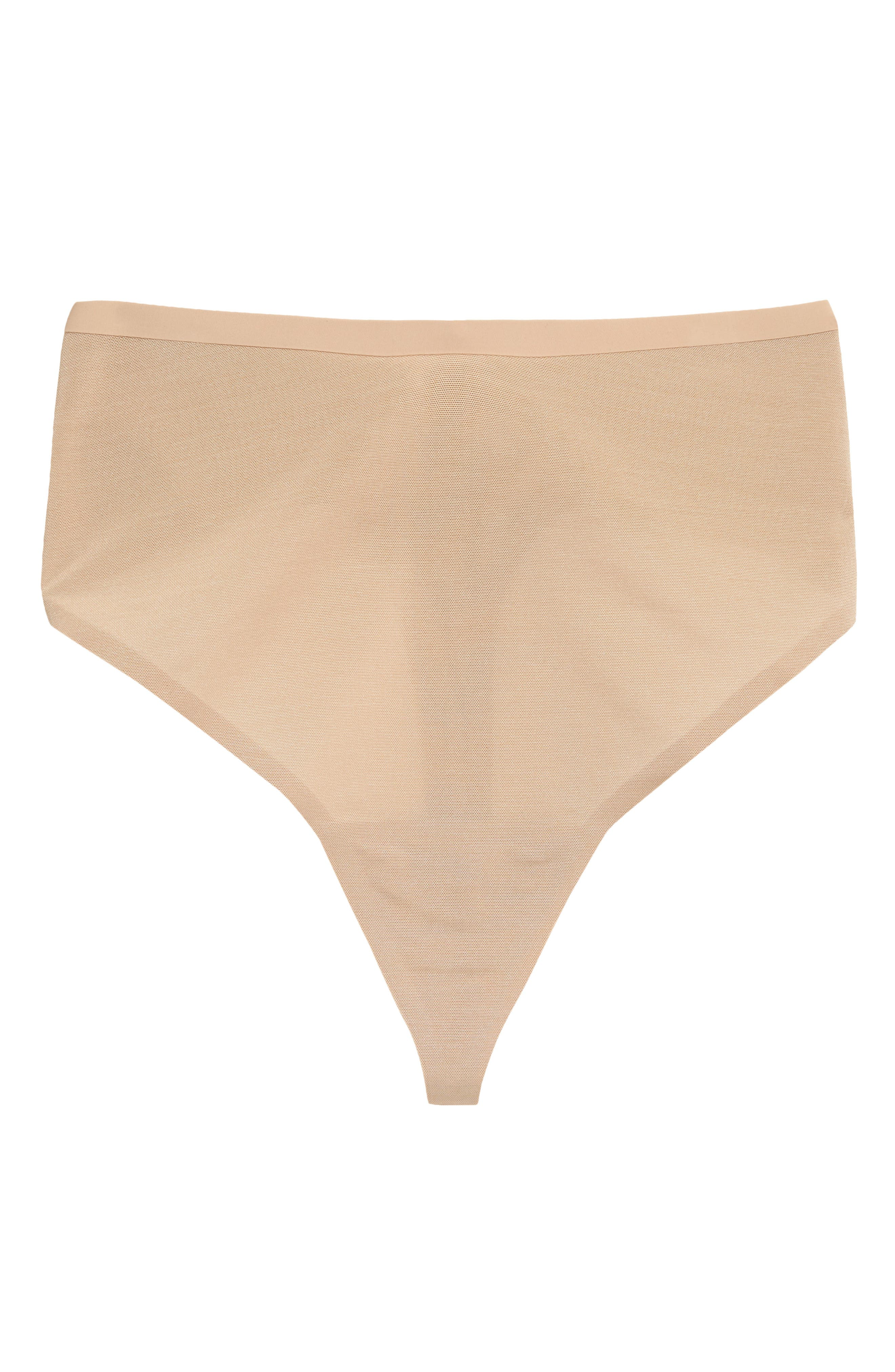 Designed to provide light compression and smoothing, this thong from Kim Kardashian West\\\'s SKIMS sits at the natural waist and is invisible under clothes. Style Name: Skims Power Mesh Mid Waist Thong (Regular & Plus Size). Style Number: 6139504. Available in stores.