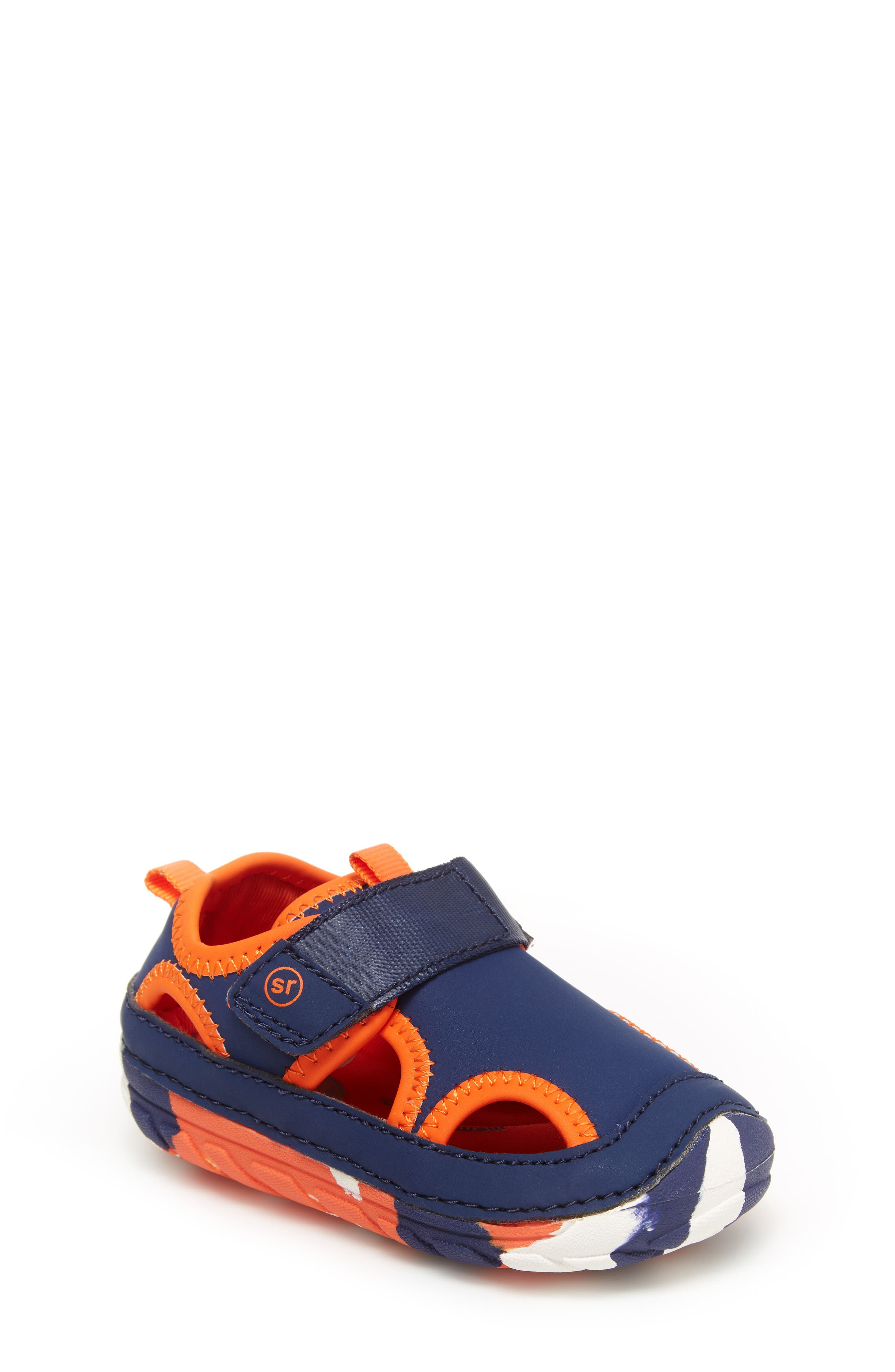 Bold color blocking and round cutouts are incredibly fun on this water-friendly shoe that encourages natural movement and supportive first steps. Style Name: Stride Rite Soft Motion Splash Water Shoe (Baby & Walker). Style Number: 5978055. Available in stores.