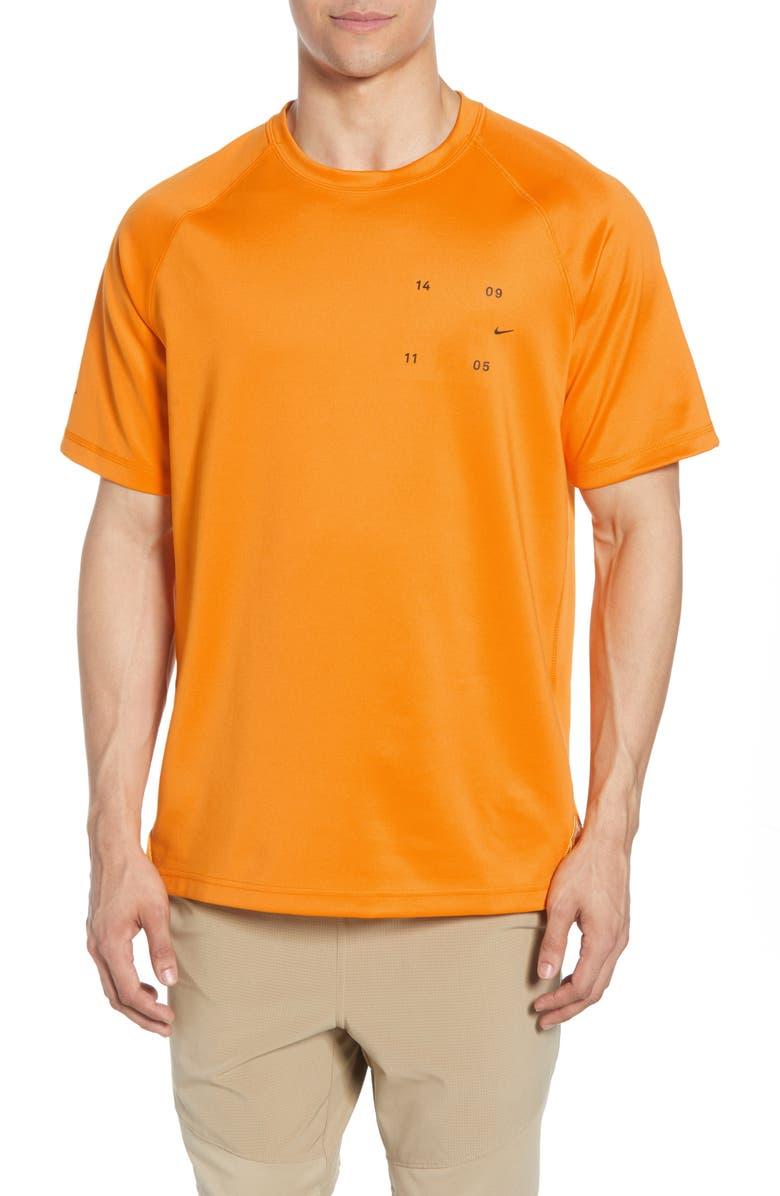 NIKE Tech Pack Short Sleeve T-Shirt, Main, color, KUMQUAT/ BLACK