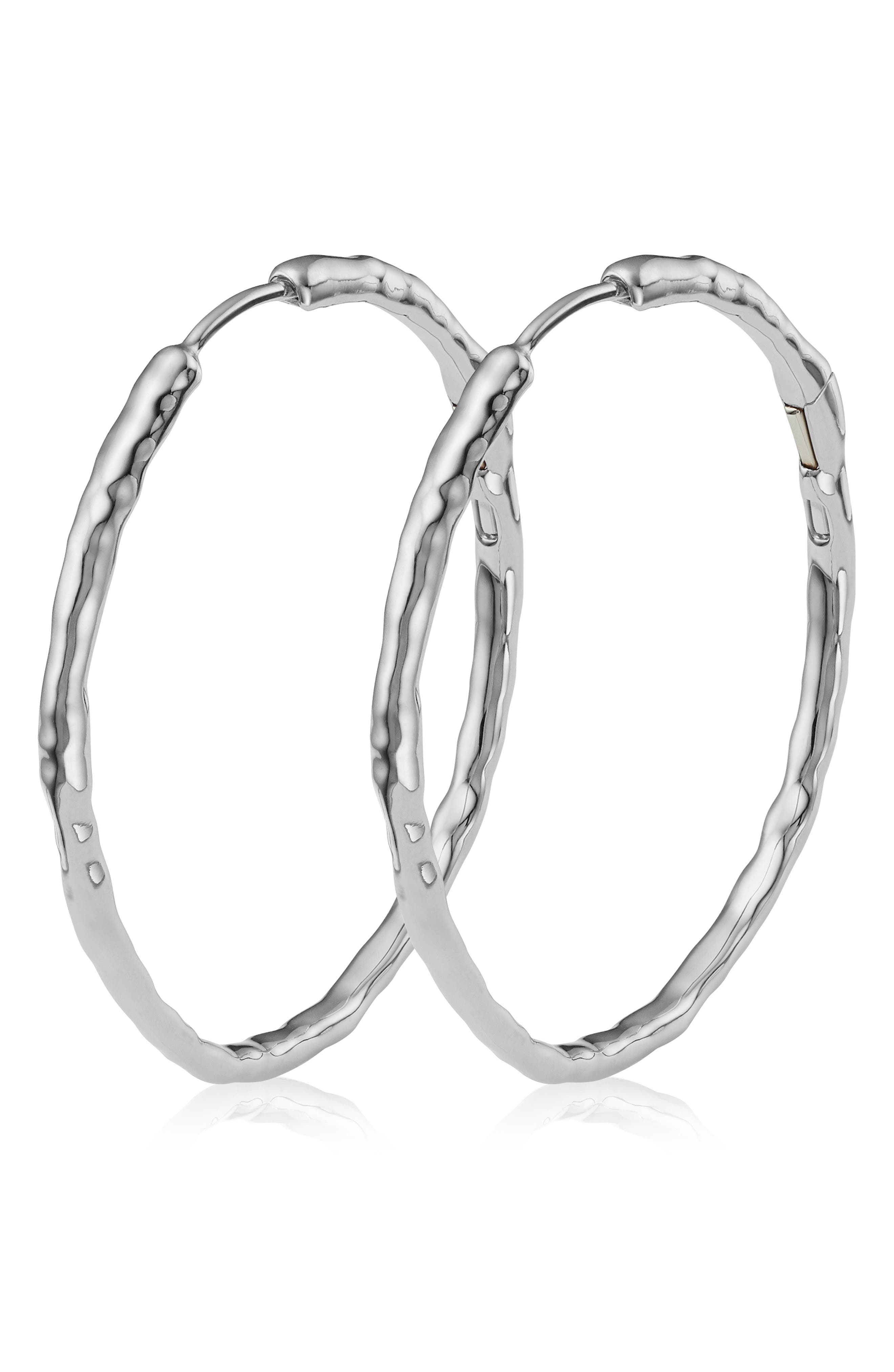 These organically shaped, high-polished hoops are beautiful worn solo, but also can be accessorized with Monica Vinader pendant charms, sold separately. Style Name: Monica Vinader Siren Muse Large Hoop Earrings. Style Number: 6028312. Available in stores.