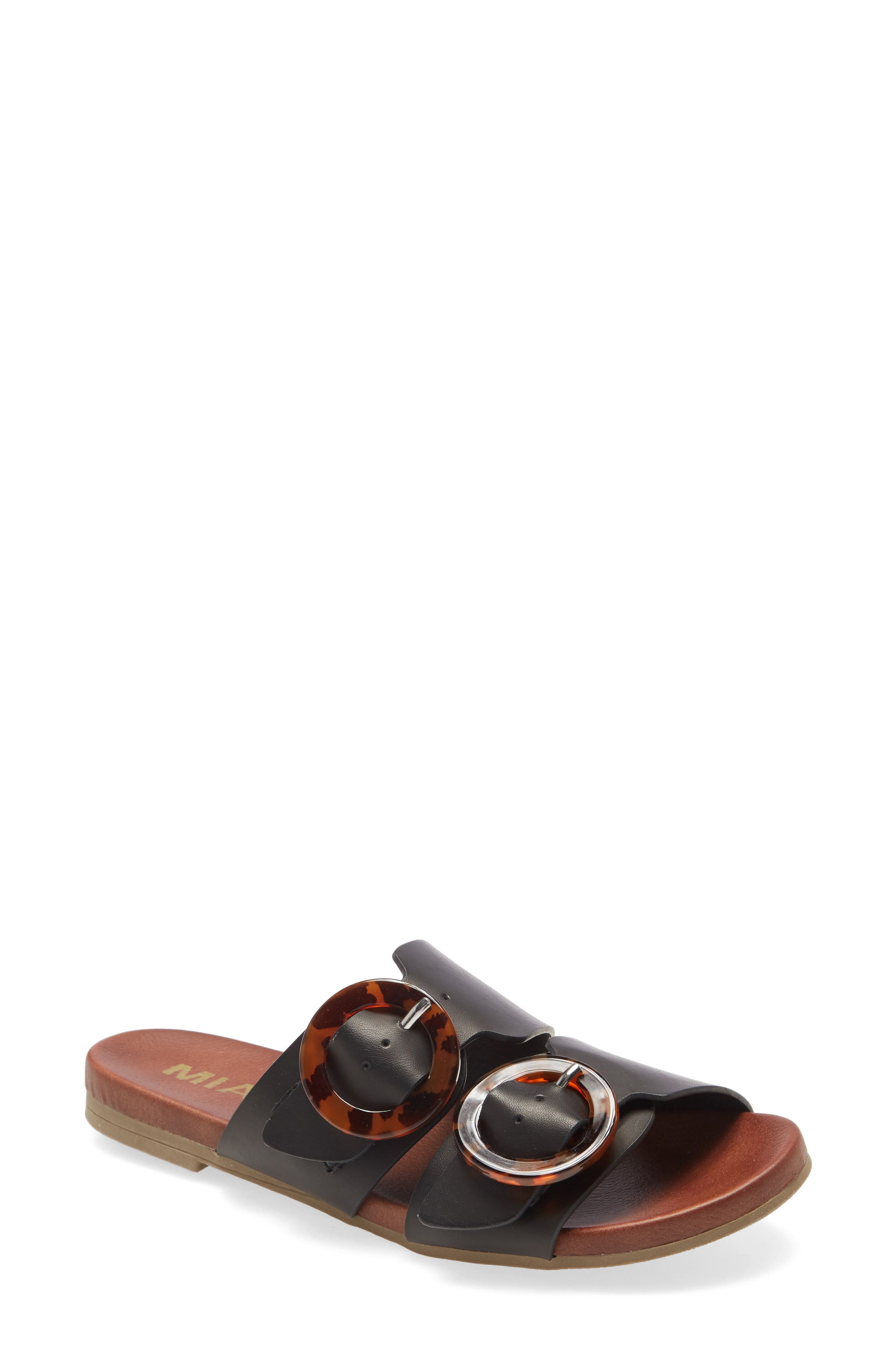 Tortoiseshell-patterned buckles embellish the dual straps of a vintage-inspired sandal set on a lightly cushioned footbed. Style Name: Mia Edina Slide Sandal (Women). Style Number: 5993421. Available in stores.