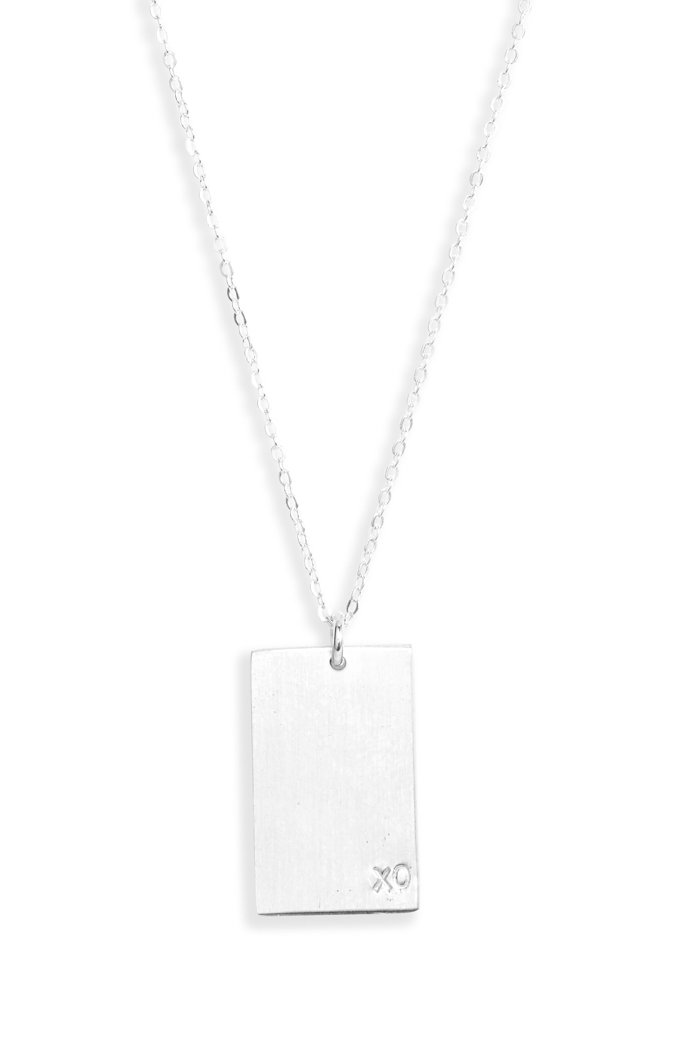 A delicate chain dangles a rectangular pendant stamped with a symbolic kiss and hug for a simply charming necklace. Style Name: Set & Stones Goldie Xo Pendant Necklace. Style Number: 6093933. Available in stores.
