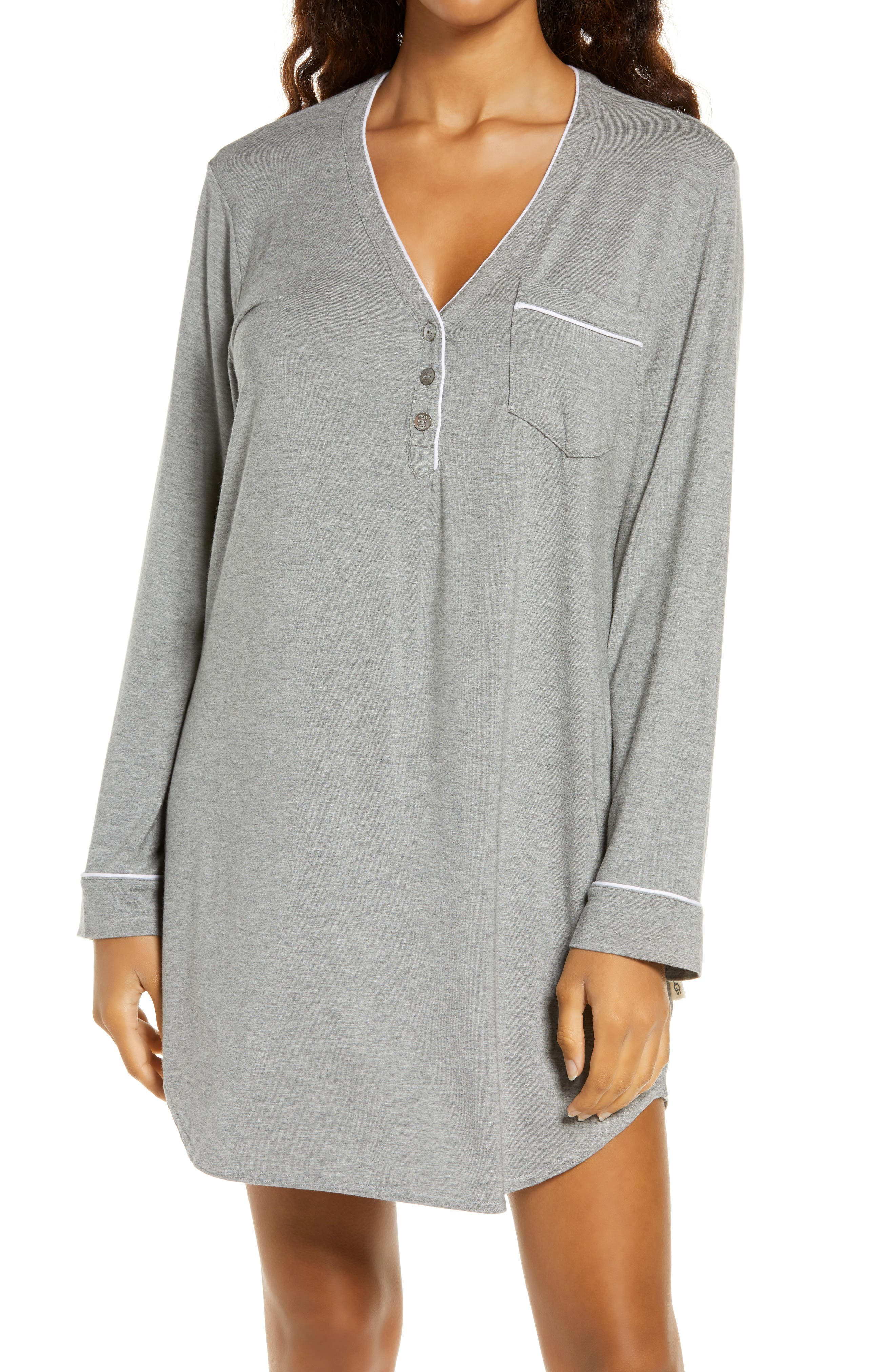 Get cozy-comfy for the evening in this jersey sleep shirt styled with a henley-style V-neck, a chest pocket and optic-white piped detailing. Style Name: UGG Henning Ii Henley Sleep Shirt. Style Number: 6094313. Available in stores.