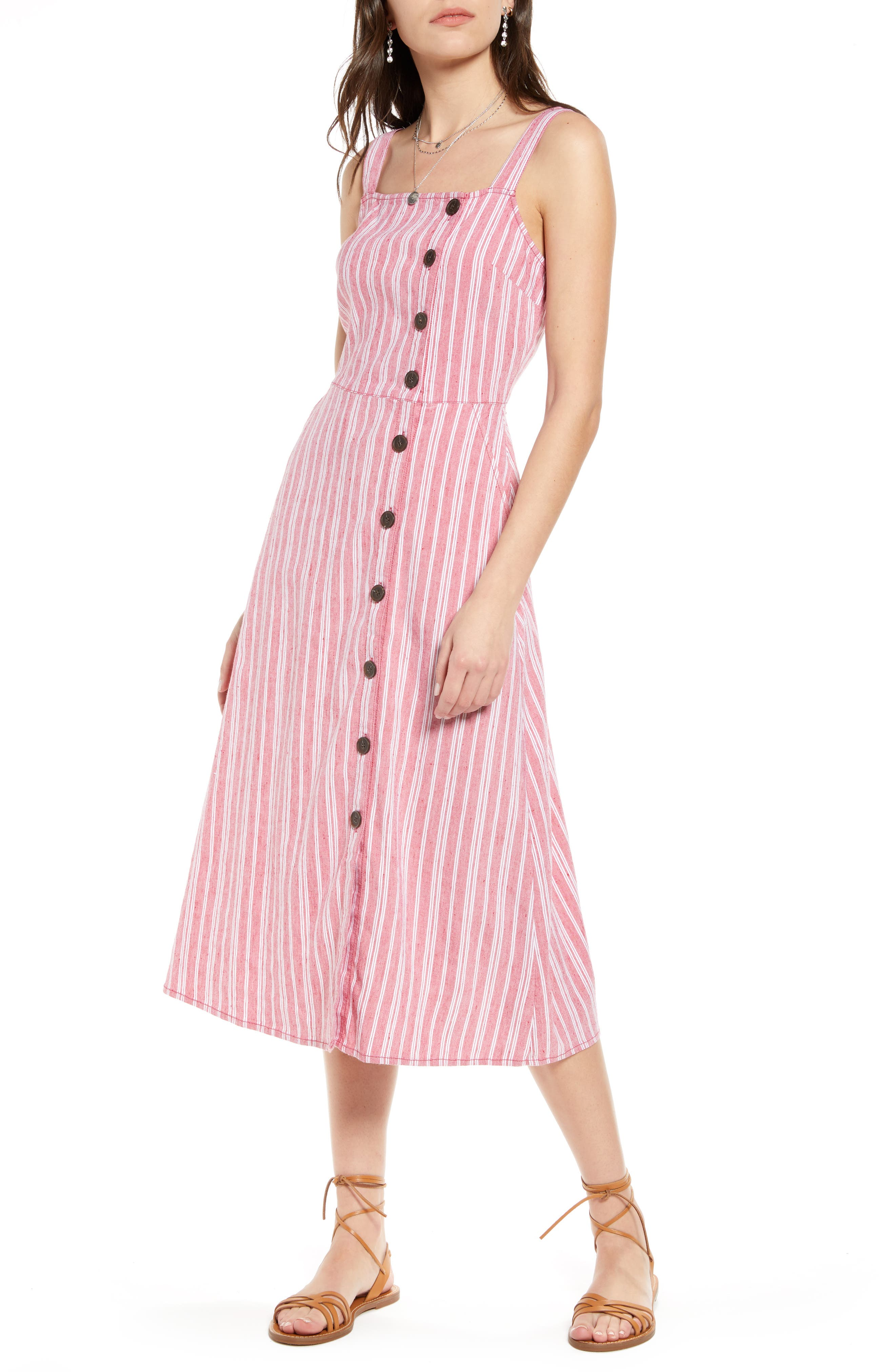 This striped sleeveless dress is styled with an off-center row of buttons and shaped from soft and refreshing linen-blend fabric. When you buy Treasure & Bond, Nordstrom will donate 2.5% of net sales to organizations that work to empower youth. Style Name: Treasure & Bond Asymmetrical Button Linen Blend Midi Dress. Style Number: 5963655. Available in stores.