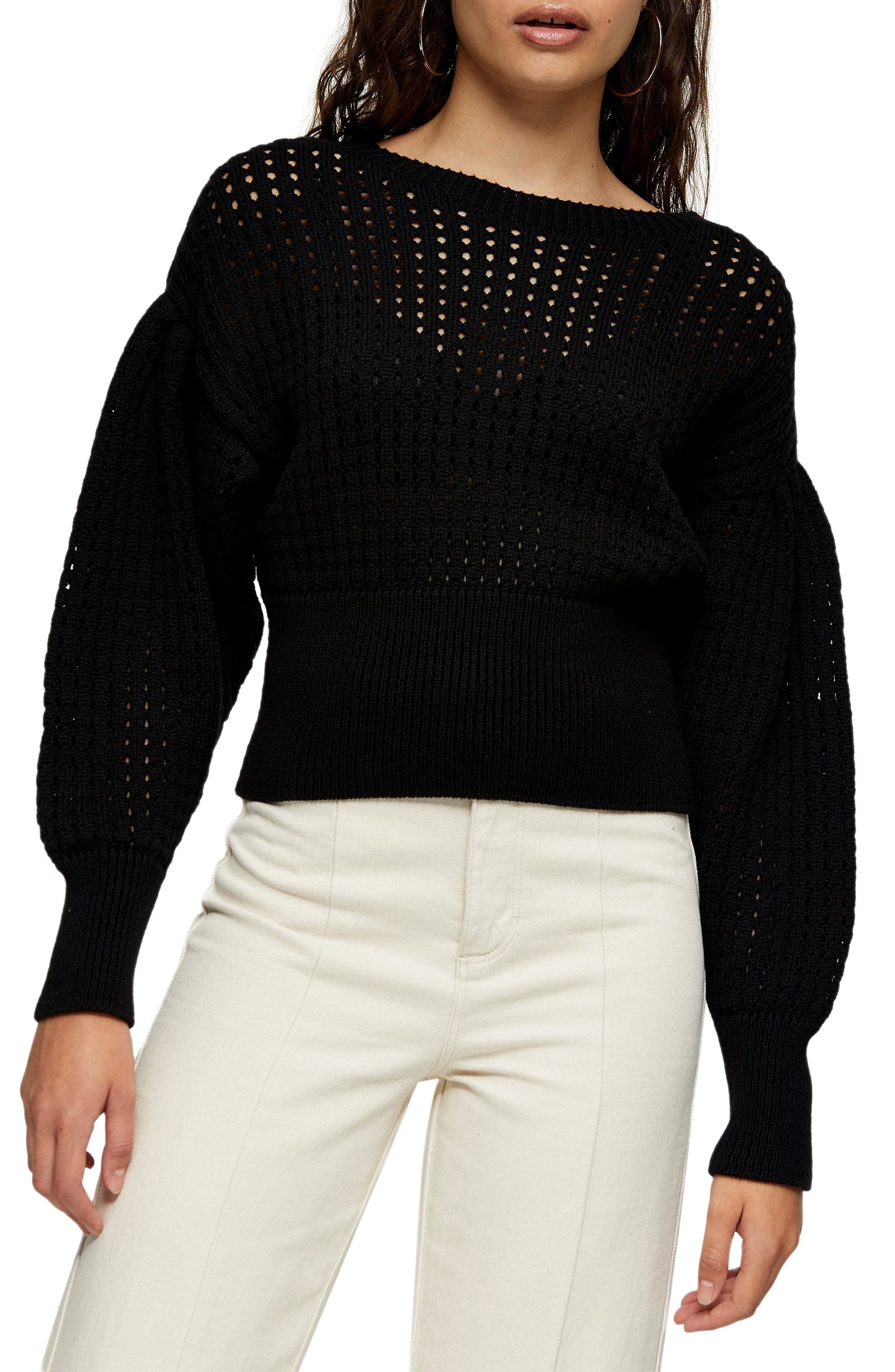 Pretty, puffed sleeves add drama to this cozy, cropped open-knit pullover. Style Name: Topshop Drama Sleeve Open Knit Sweater. Style Number: 6112129. Available in stores.