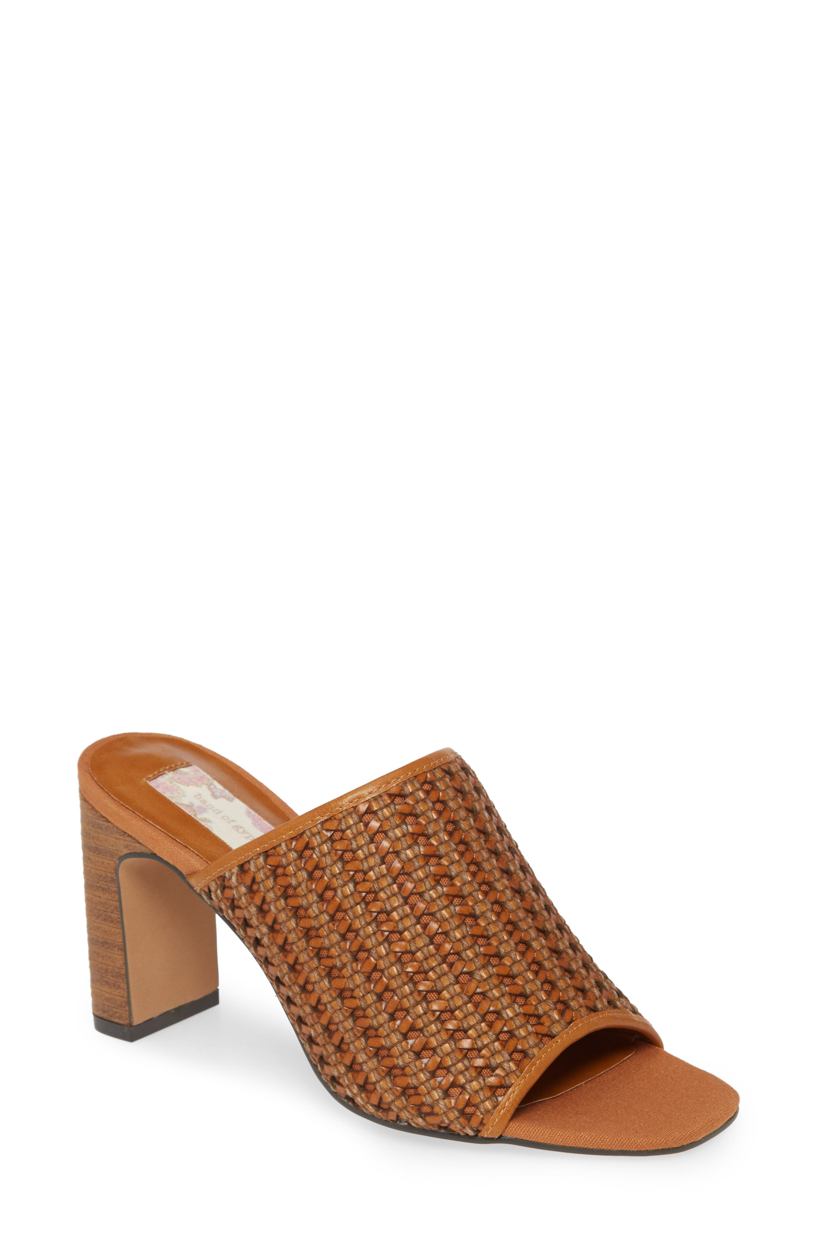 Full of boho-chic style, this sandal has a woven mixed-media upper and a tall heel with a stacked and weathered finish. Style Name: Band Of Gypsies Hermosa Woven Slide Sandal (Women). Style Number: 5982374. Available in stores.