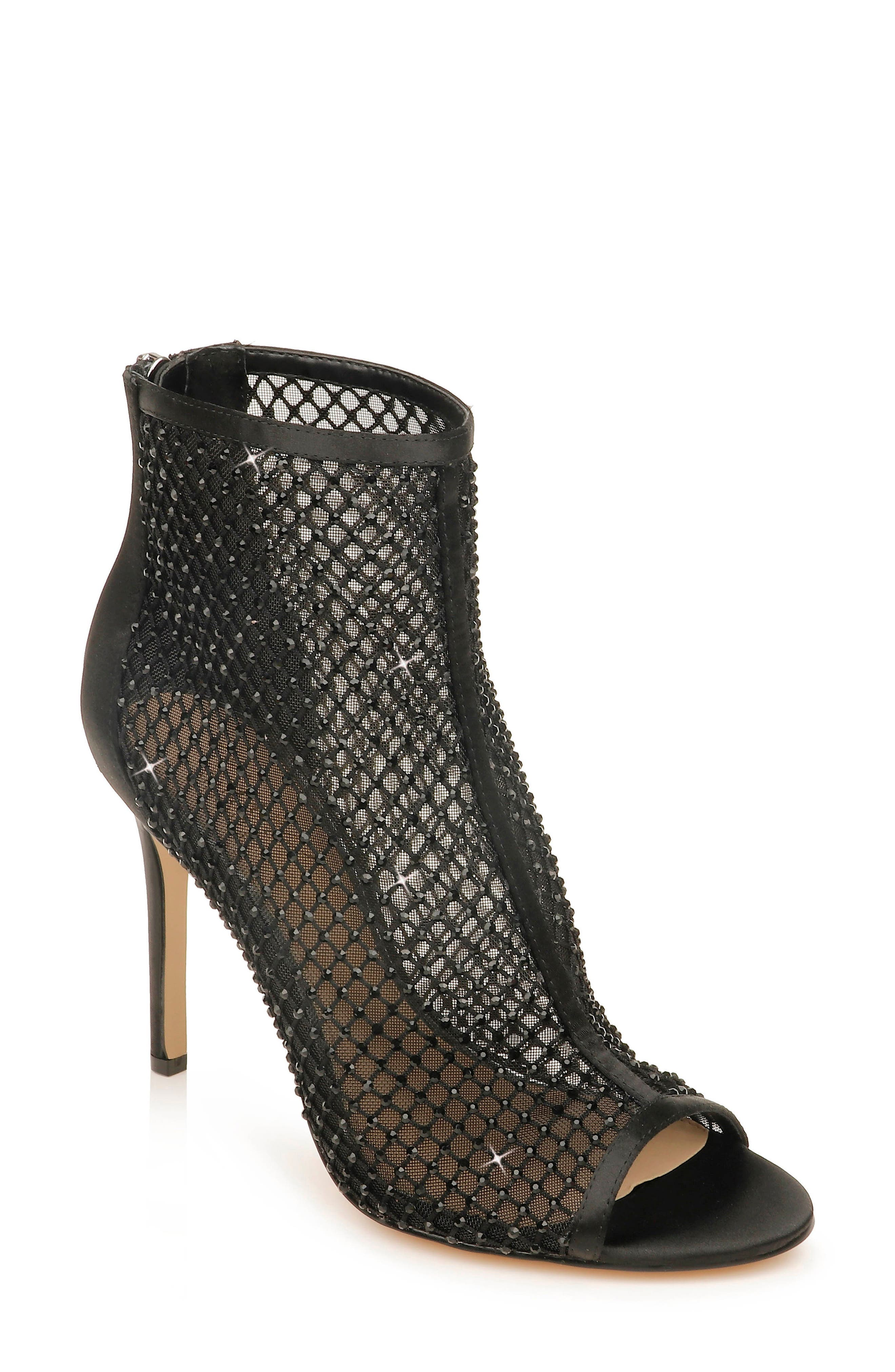 Glittering crystals dazzle on a sultry mesh-and-satin bootie styled with a flirty peep toe and towering stiletto heel. Style Name: Jewel Badgley Mischka Fiorella Mesh Bootie (Women). Style Number: 6068846. Available in stores.
