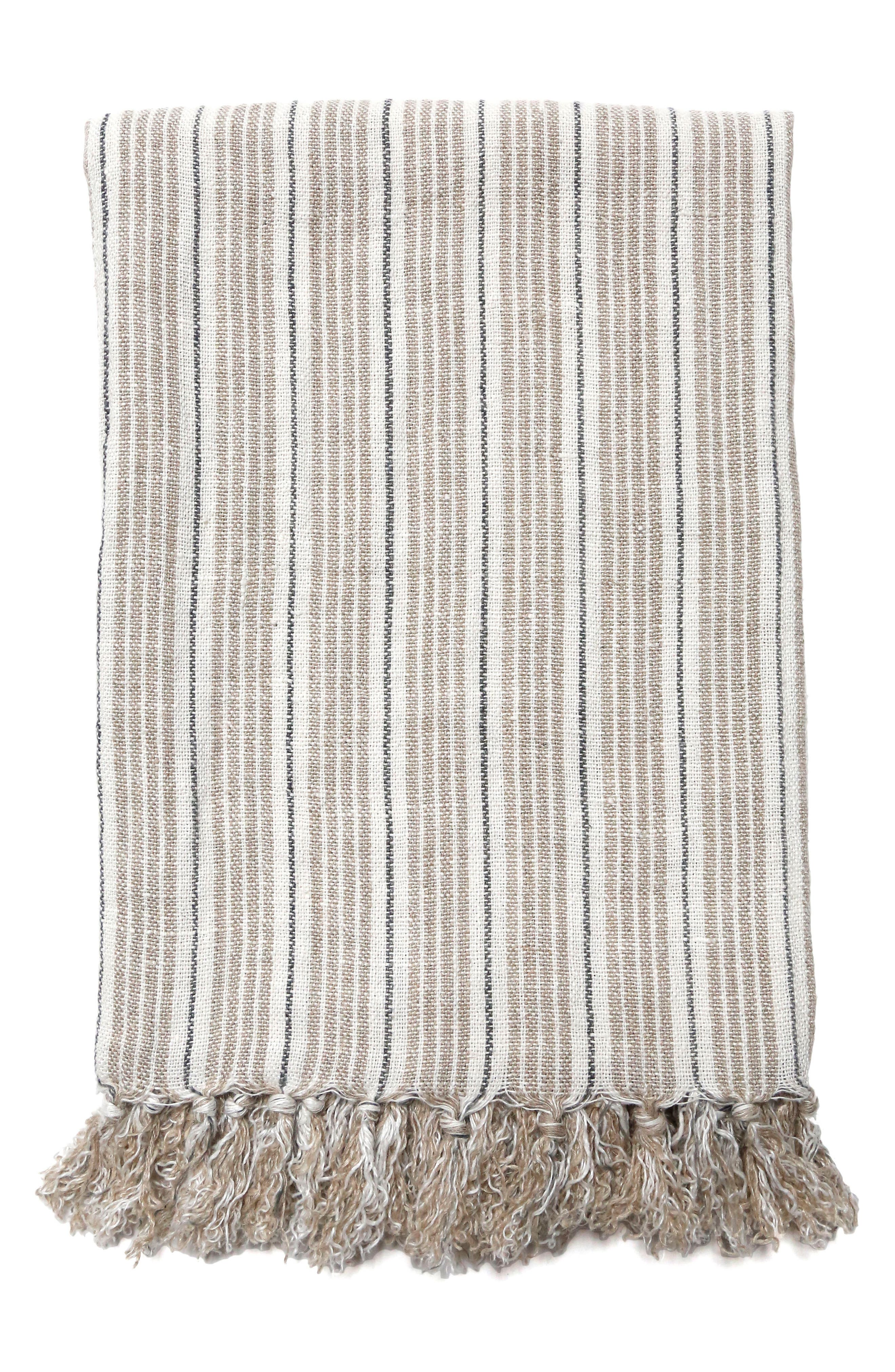 Hand-loomed from soft, heavy linen, this beautifully striped throw blanket is finished with thick, lush tassels. Style Name: Pom Pom At Home Newport Throw Blanket. Style Number: 5437461. Available in stores.