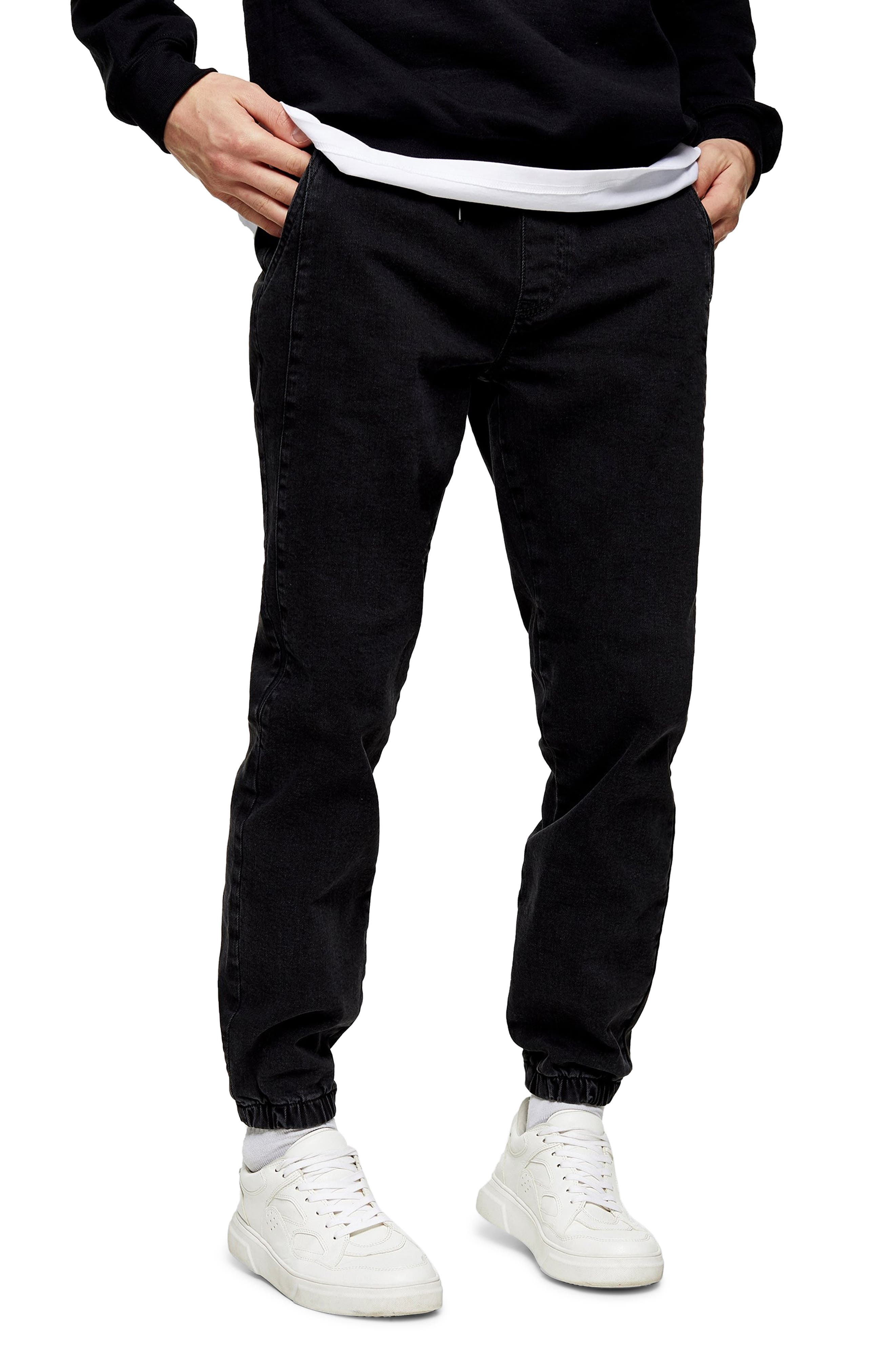 Light fading softens the inky blackness of sporty stretch-denim joggers cut with a close fit that looks modern and stays comfortable. Style Name: Topman Denim Joggers. Style Number: 6130986. Available in stores.