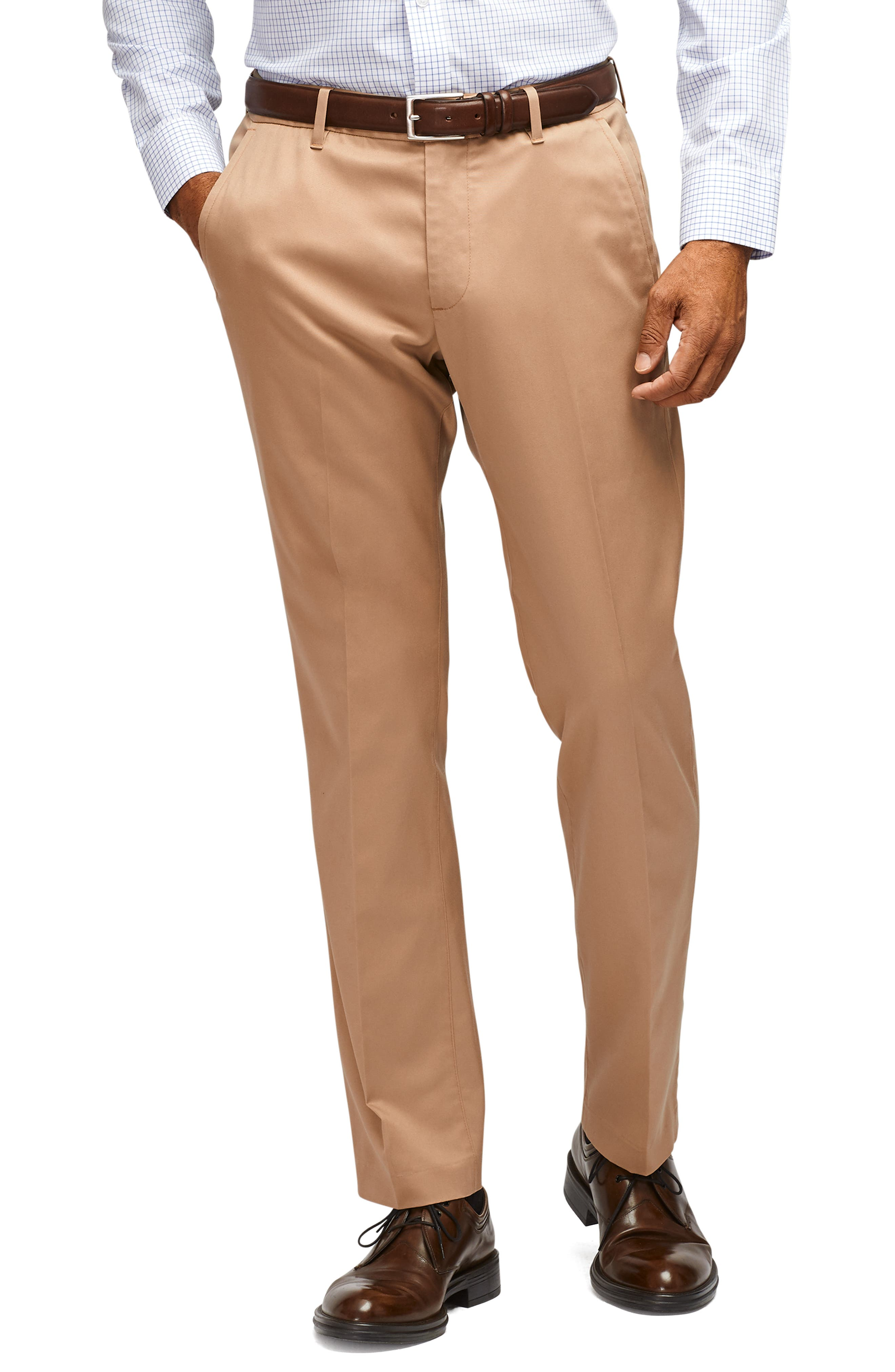 A sharp look for any day of the week, these flat-front pants are made from soft, easy-care stretch fabric and cut for a trim (but not tight) fit. Style Name: Bonobos Stretch Weekday Warrior Slim Fit Dress Pants. Style Number: 5647316. Available in stores.
