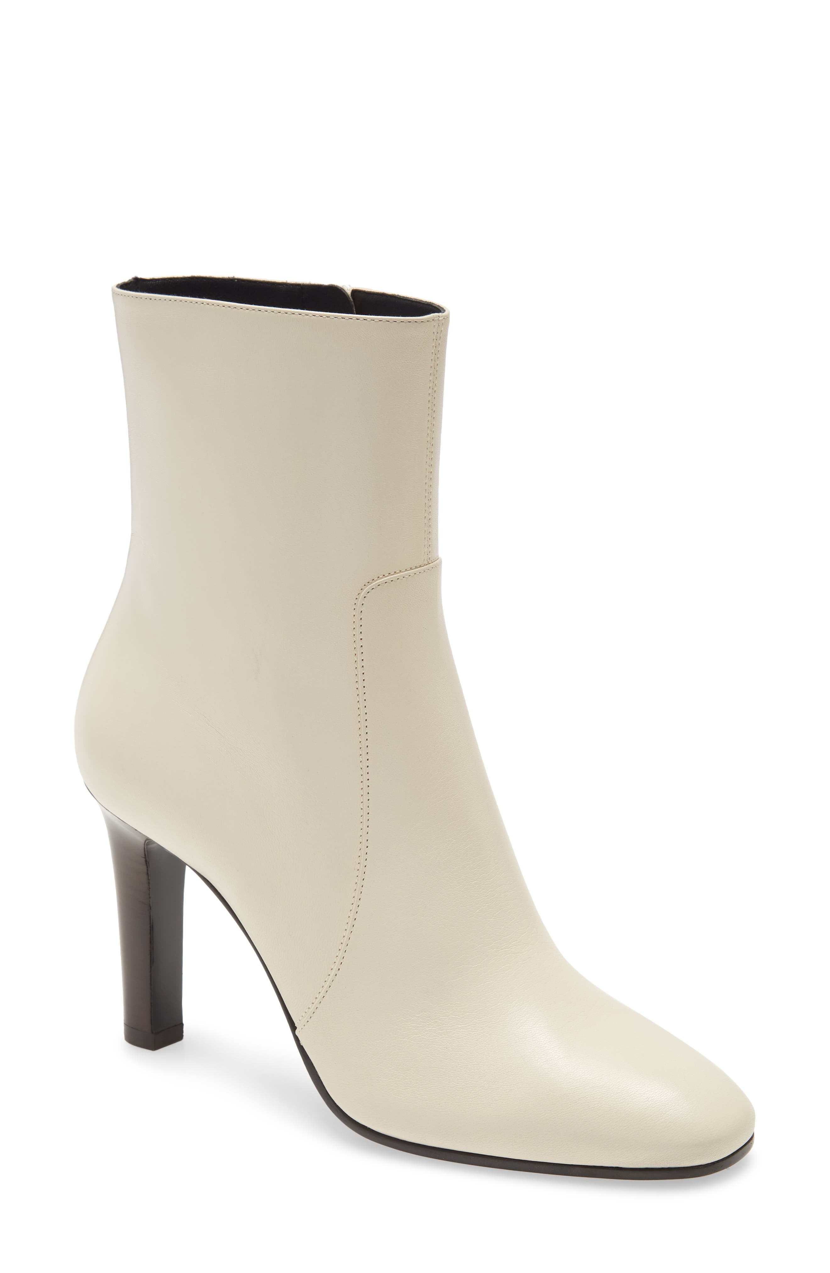 Classic and contemporary at the same time, this bootie is crafted in Italy from smooth leather with a subtly squared toe and slender stacked heel. Style Name: Saint Laurent Blu Bootie (Women). Style Number: 6083707. Available in stores.