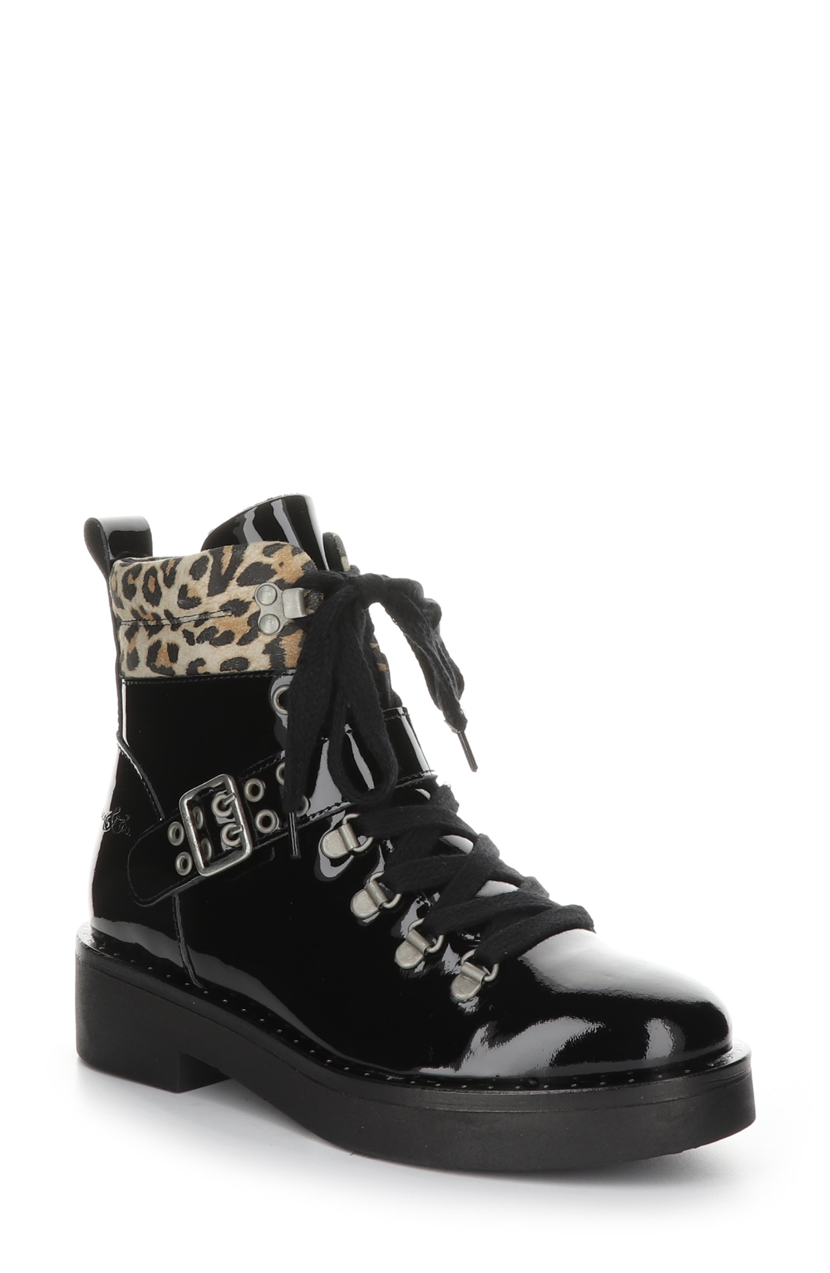 This alpine-inspired boot delivers lots of attitude and plenty of comfort as you stride along slick city streets or chilly mountain trails. Lined with fleece to keep your feet toasty warm, this boot features three layers of foam and EVA cushioning, an adjustable lace-up front and a chunky, durable rubber sole that\\\'s hollow on the inside for a lightweight feel. A buckle strap, contrast padded collar and studs along the welt give it the edge