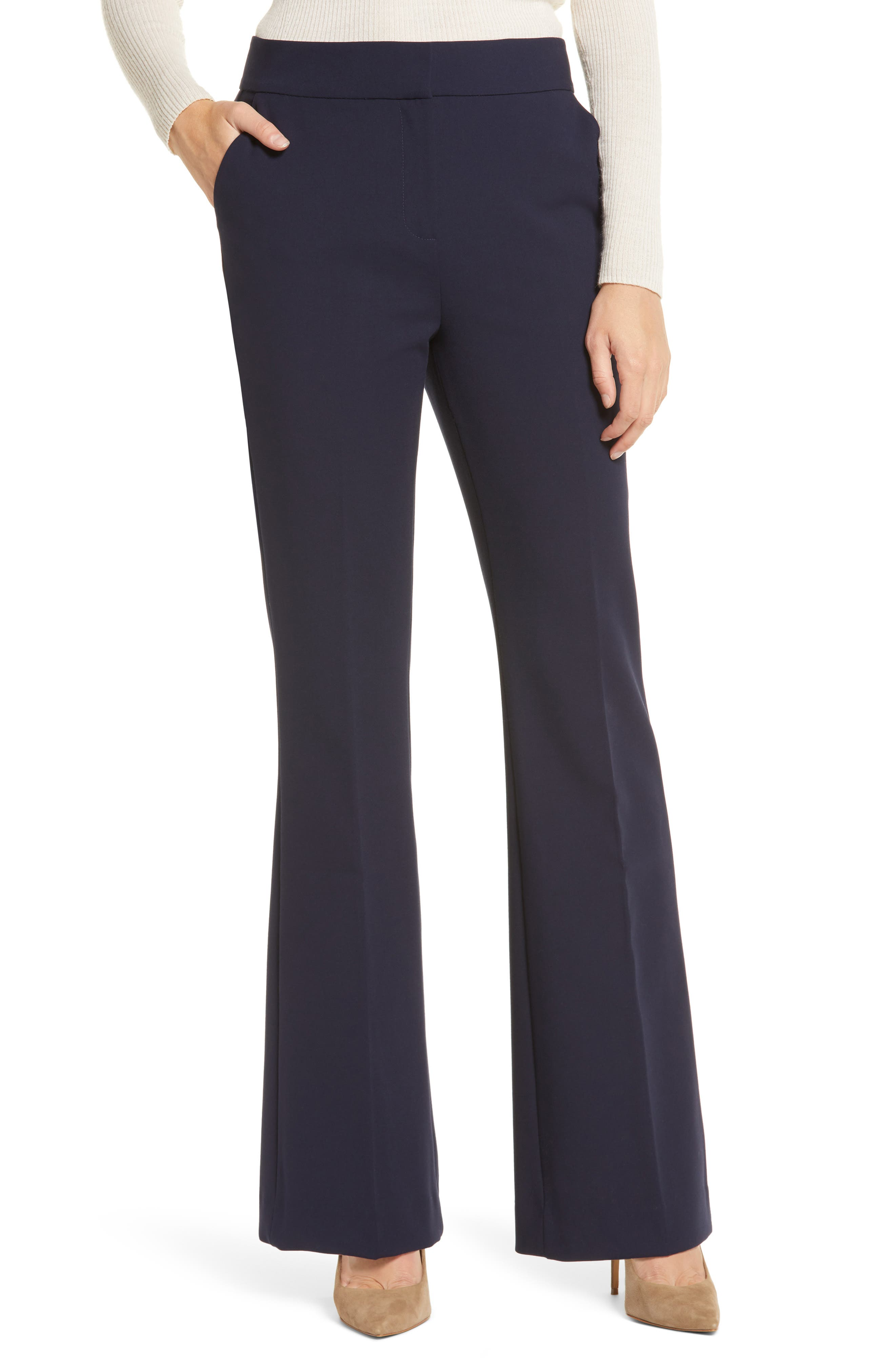 A flat front, flared legs and crisply pressed creases coordinate to create this pair of pants that add comfort into the workwear-update equation. Style Name: Halogen Flare Leg Pants (Regular & Petite). Style Number: 6011444. Available in stores.