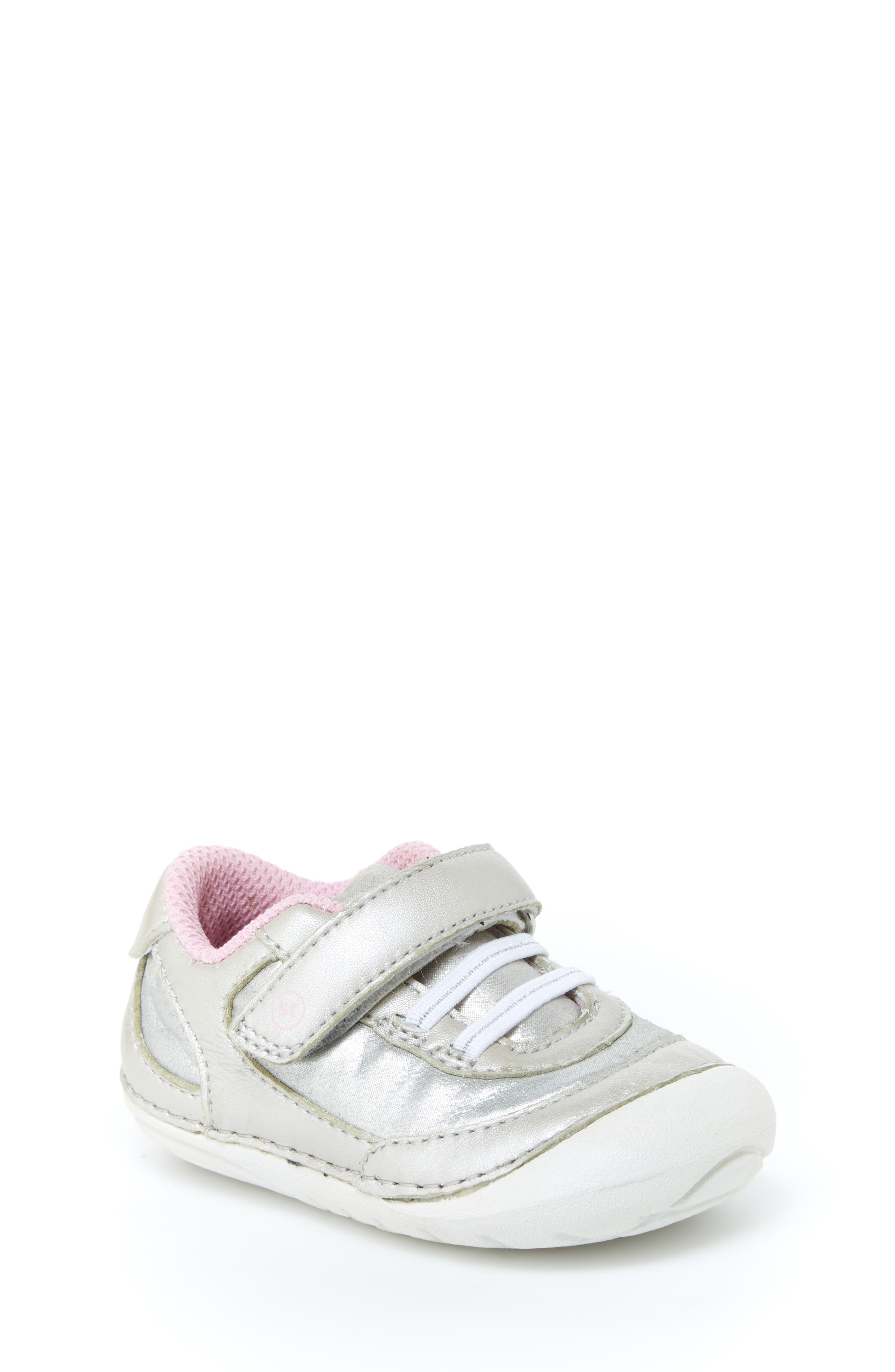 Keep little ones on their toes with a shimmery leather sneaker featuring an easy-on strap and cushy memory foam insole. Soft Motion technology increases flexibility and helps kids improve balance and develop a natural, healthy gait. Style Name: Stride Rite Jazzy Soft Motion Sneaker (Baby & Walker). Style Number: 5689935. Available in stores.