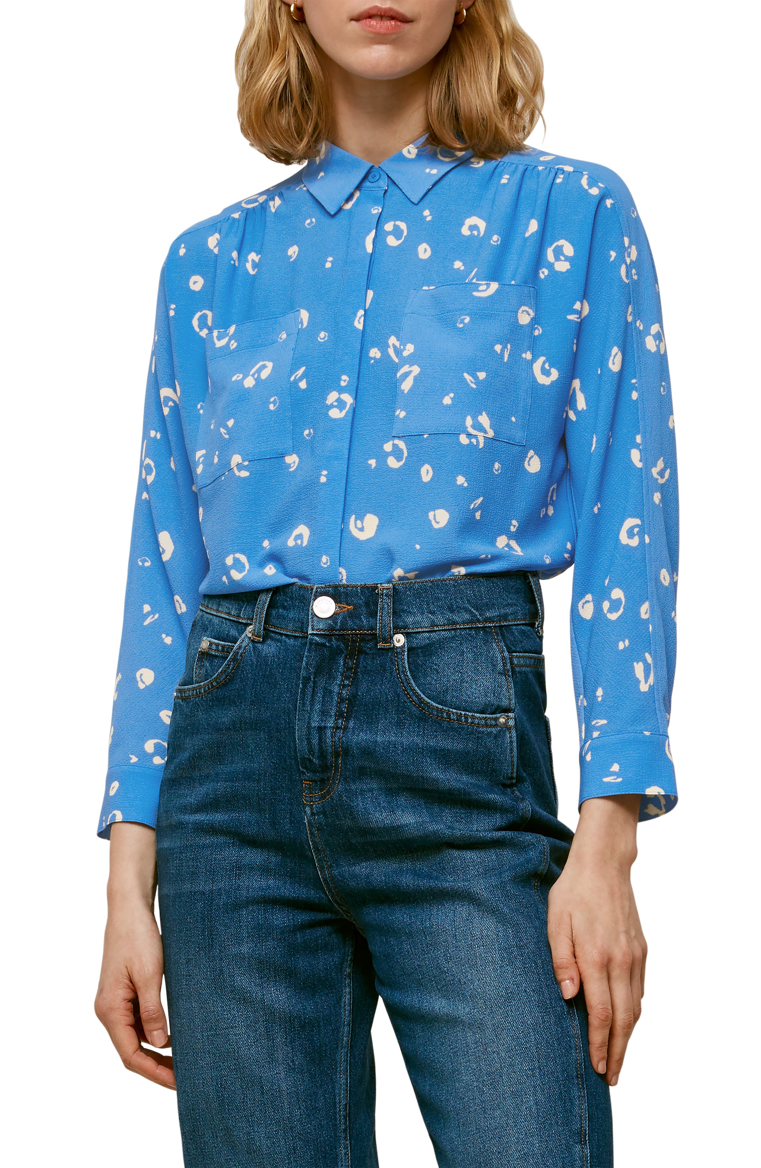 Abstract spots on a sky-blue crepe backdrop are a softened take on the fierce animal trend on this elevated shirt with a covered placket and gathered accents. Style Name: Whistles Watercolor Animal Print Shirt. Style Number: 6020948. Available in stores.