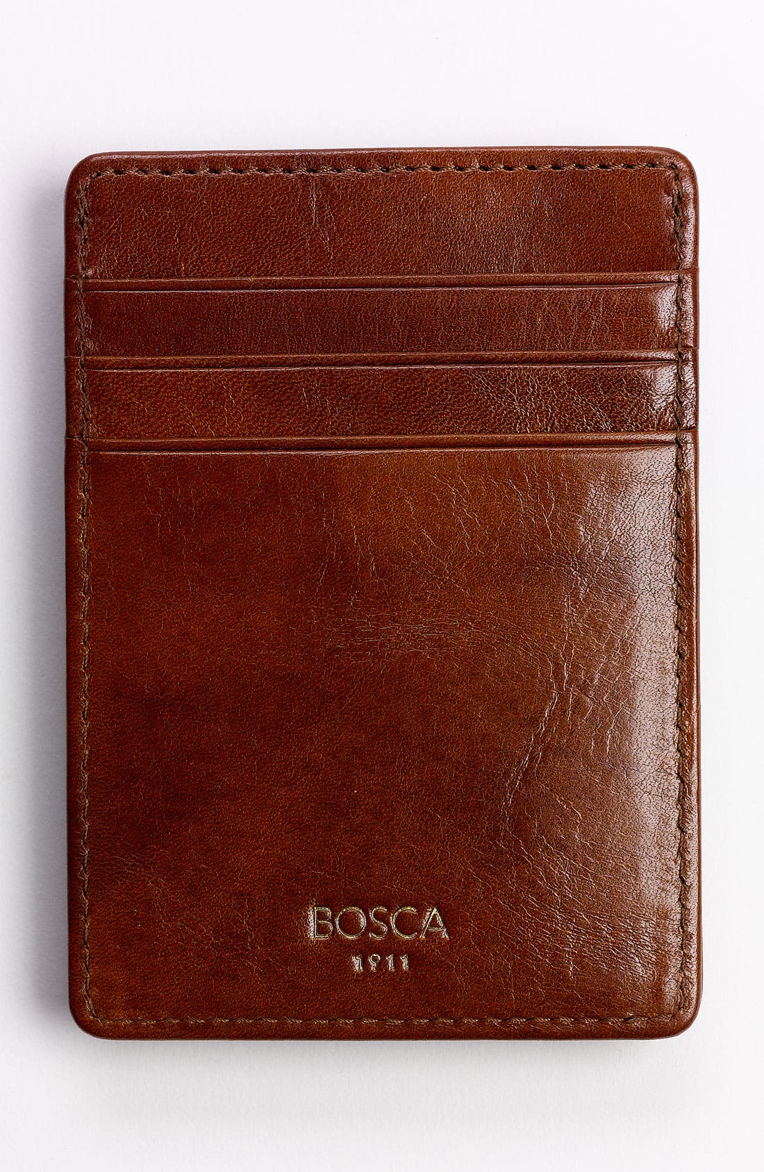 A sturdy, wrapped money clip fronts a slim front-pocket wallet crafted from high-shine leather with a rich grain. Style Name: Bosca Old Leather Front Pocket Wallet. Style Number: 569547. Available in stores.