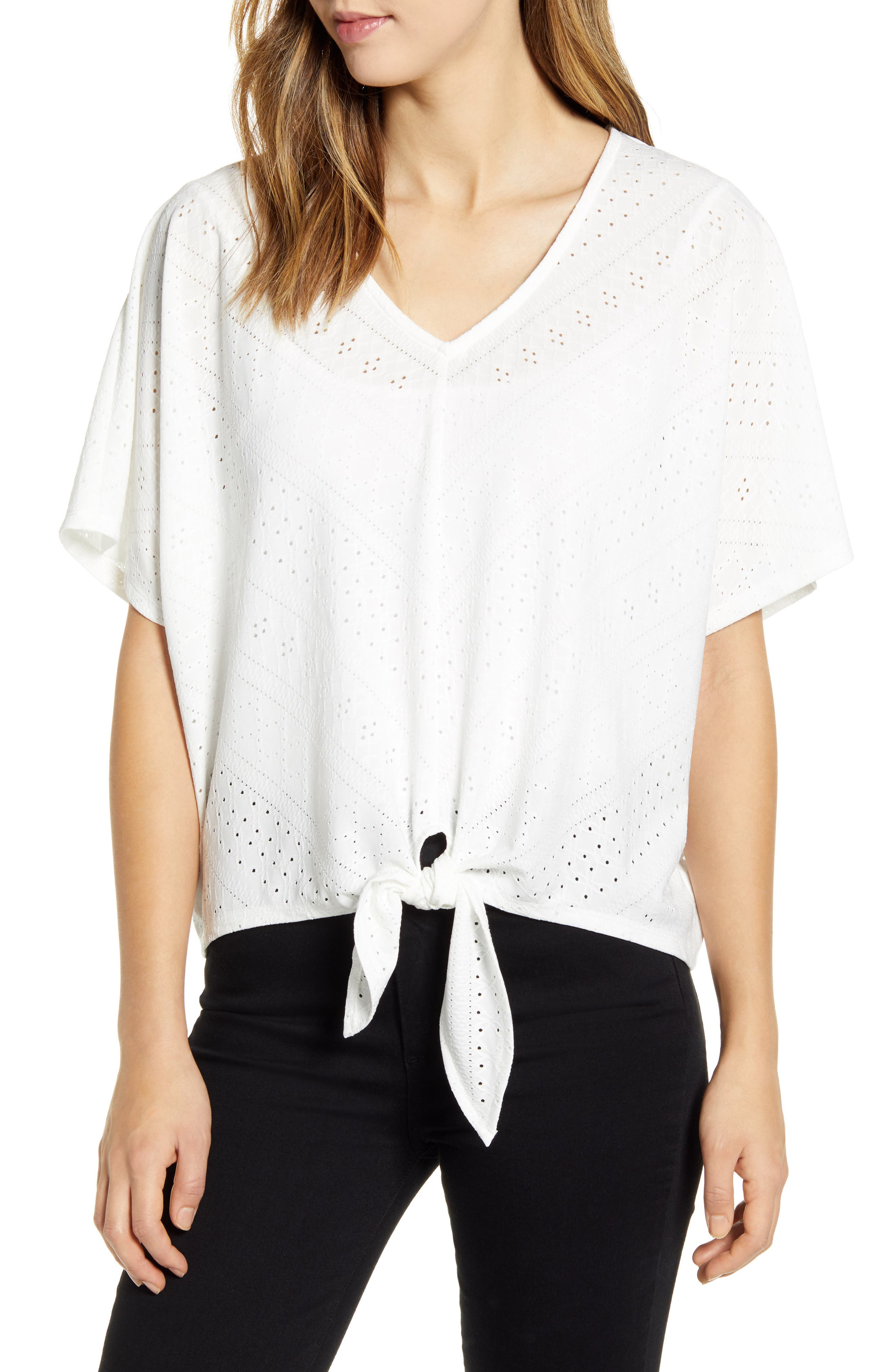 Airy pointelle jacquard brings charm to this summery top designed with drapey dolman sleeves and a cinched tie front. Style Name: Wit & Wisdom Pointelle Tie Front Top (Nordstrom Exclusive). Style Number: 6012666. Available in stores.
