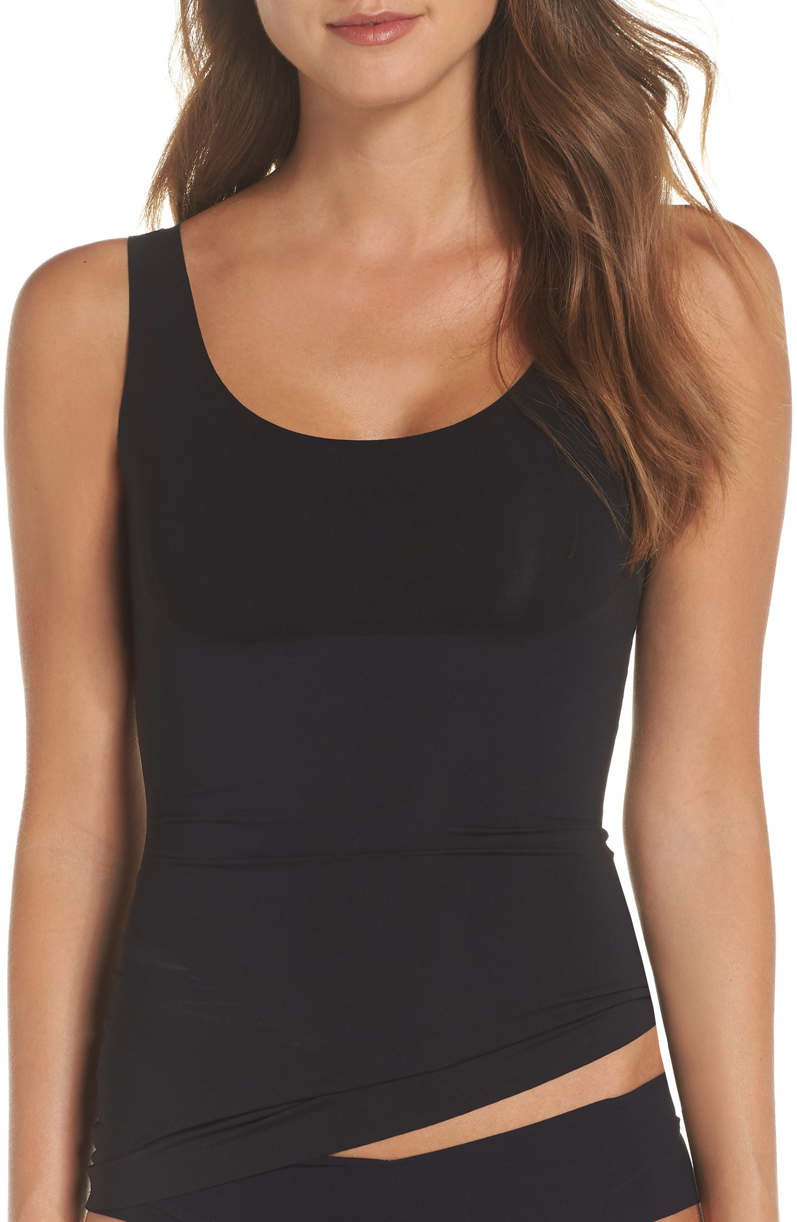 A slimming tank made from lightweight, breathable microfiber creates a smooth look under clothing without compressing the bust. Style Name: Spanx Thinstincts Tank. Style Number: 5666961. Available in stores.