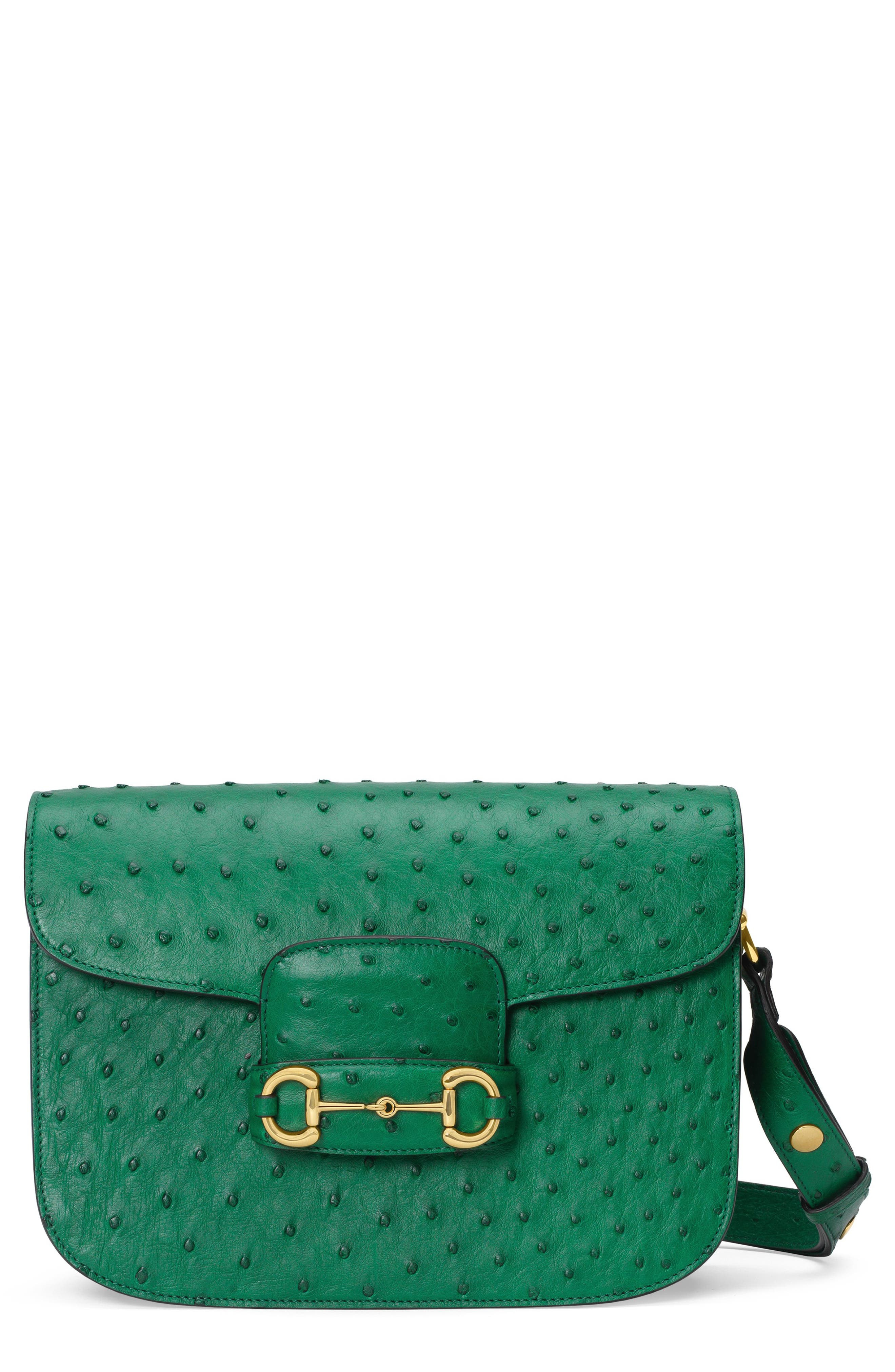 Pre-order this style today! Add to Shopping Bag to view approximate ship date. You\\\'ll be charged only when your item ships.A new design for the season based on a classic from the 1950s, this shoulder bag highlights the house horsebit with gleaming hardware at the flap and sides. The style is made from genuine ostrich skin, with its distinctive texture highlighted in a rich emerald green hue. Style Name: Gucci 1955 Horsebit Ostrich Shoulder Bag.