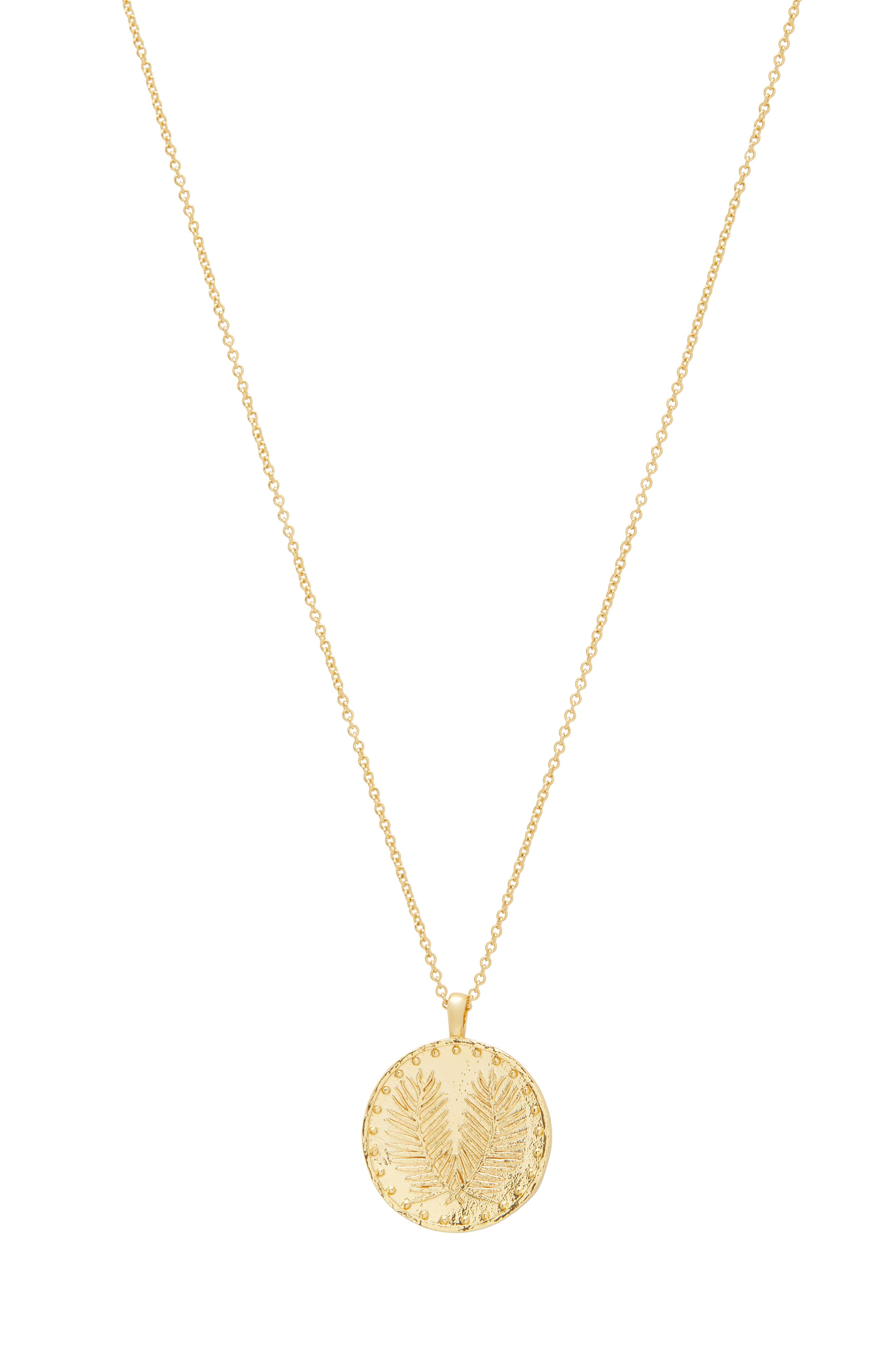 Raised palm-frond detailing adds to the striking found-object aesthetic of an adjustable coin-pendant necklace plated in 18-karat gold. Style Name: Gorjana Palm Coin Pendant Necklace. Style Number: 5783256. Available in stores.