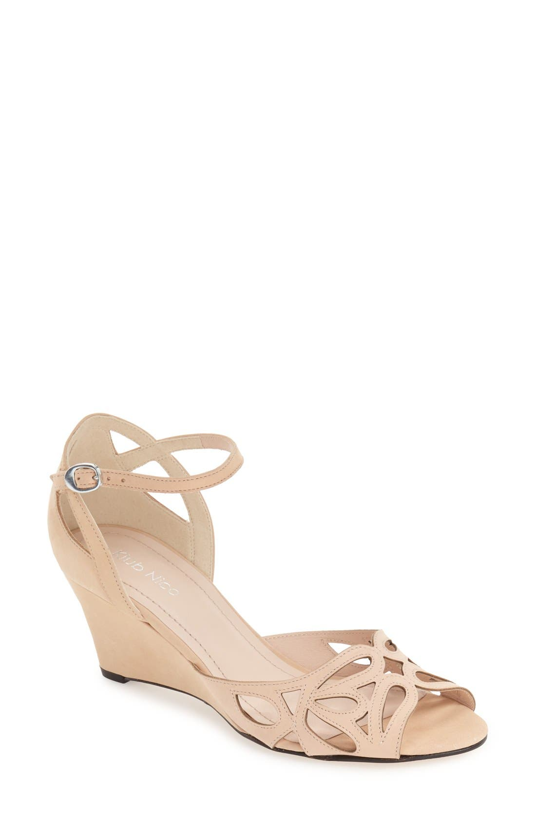 Pretty teardrop cutouts detail the toe strap of a graceful ankle-strap sandal lifted by a cohesive covered wedge. Style Name: Klub Nico \\\'Kismet\\\' Wedge Sandal (Women). Style Number: 5115202. Available in stores.