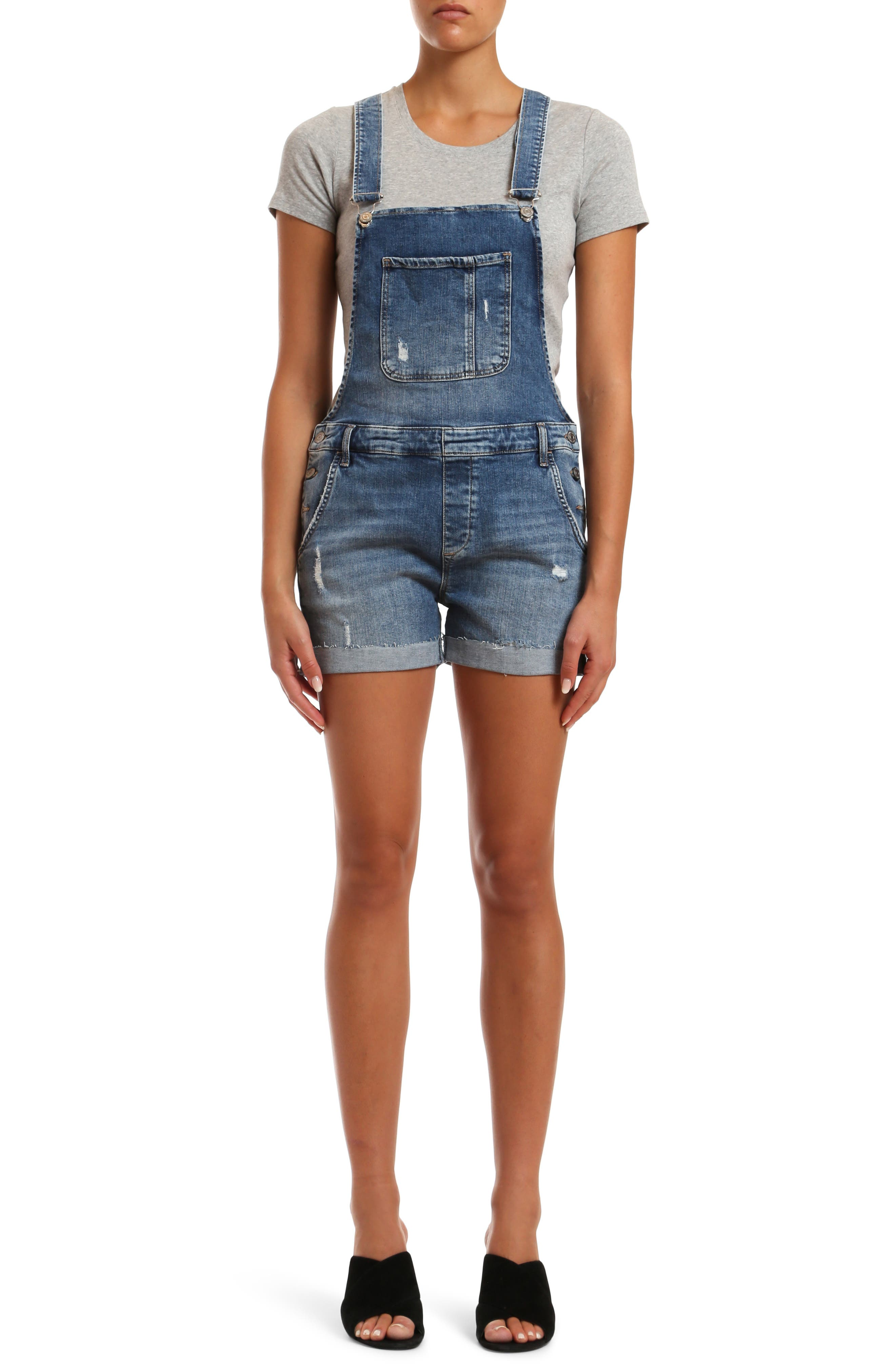 A preloved vibe authenticates these faded short overalls that are ready to own the laid-back sunny season. Style Name: Mavi Jeans Wanda Used Ripped Denim Short Overalls. Style Number: 5999169. Available in stores.