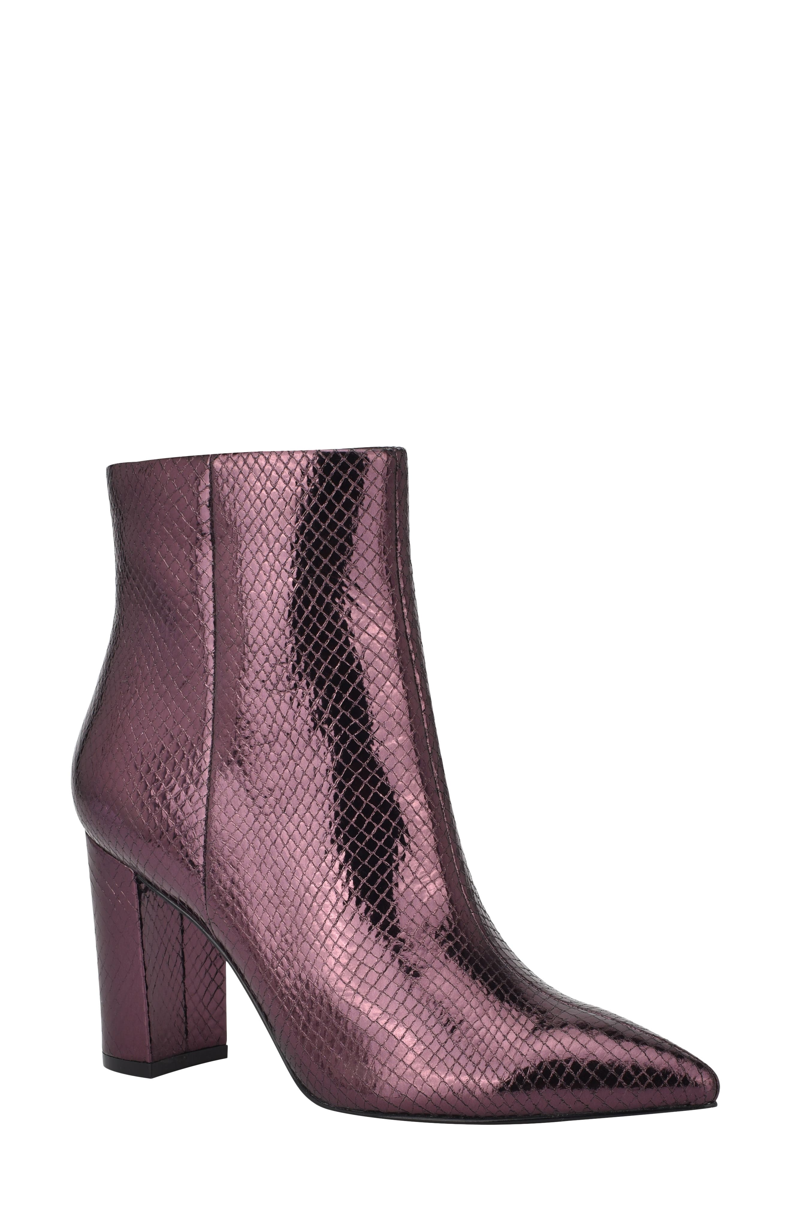 A curved, half-moon heel elevates a sleek and striking bootie crafted from supple leather in a pointy-toe silhouette. Style Name: Marc Fisher Ltd Ulani Pointy Toe Bootie (Women). Style Number: 5593529. Available in stores.