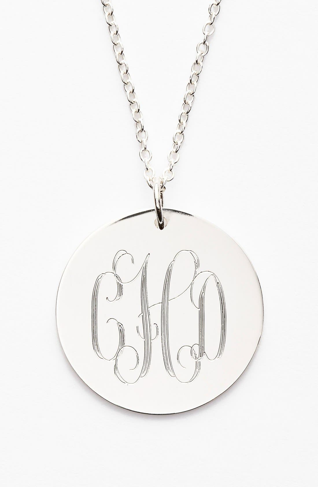 Personalize your own classic or modern monogrammed necklace with this dainty double-sided disc pendant. Hand-cut and hand-polished, this customized treasure is sure to be a delightful gift. Style Name: Jane Basch Designs Personalized Reversible Pendant Necklace. Style Number: 1015567. Available in stores.
