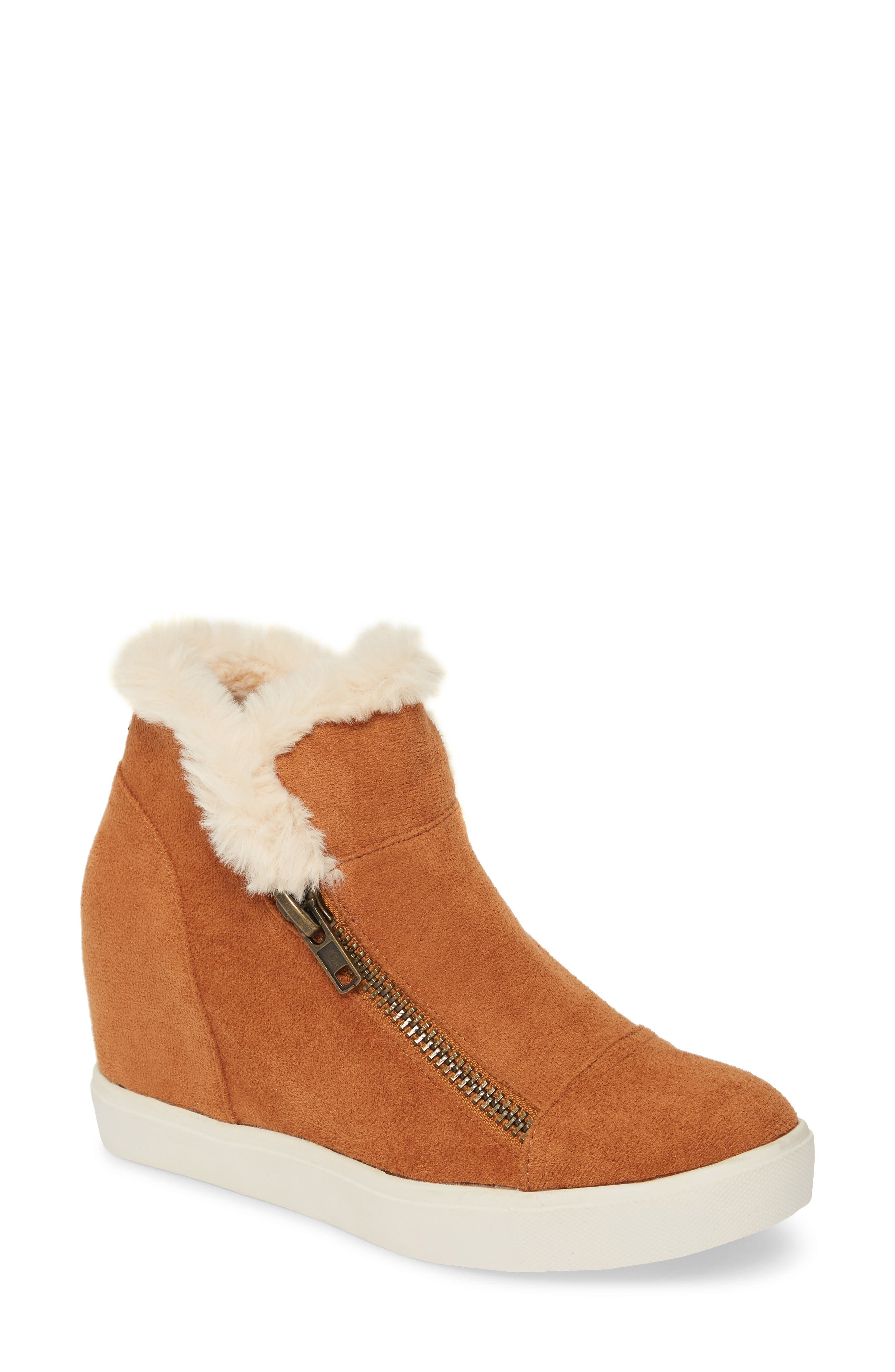 Two edgy zippers make it super easy to slip on these cozy fur-trimmed wedge sneakers and head out to take on the day. Style Name: Coconuts By Matisse Later Days Faux Fur Wedge Sneaker (Women). Style Number: 5893539 1. Available in stores.