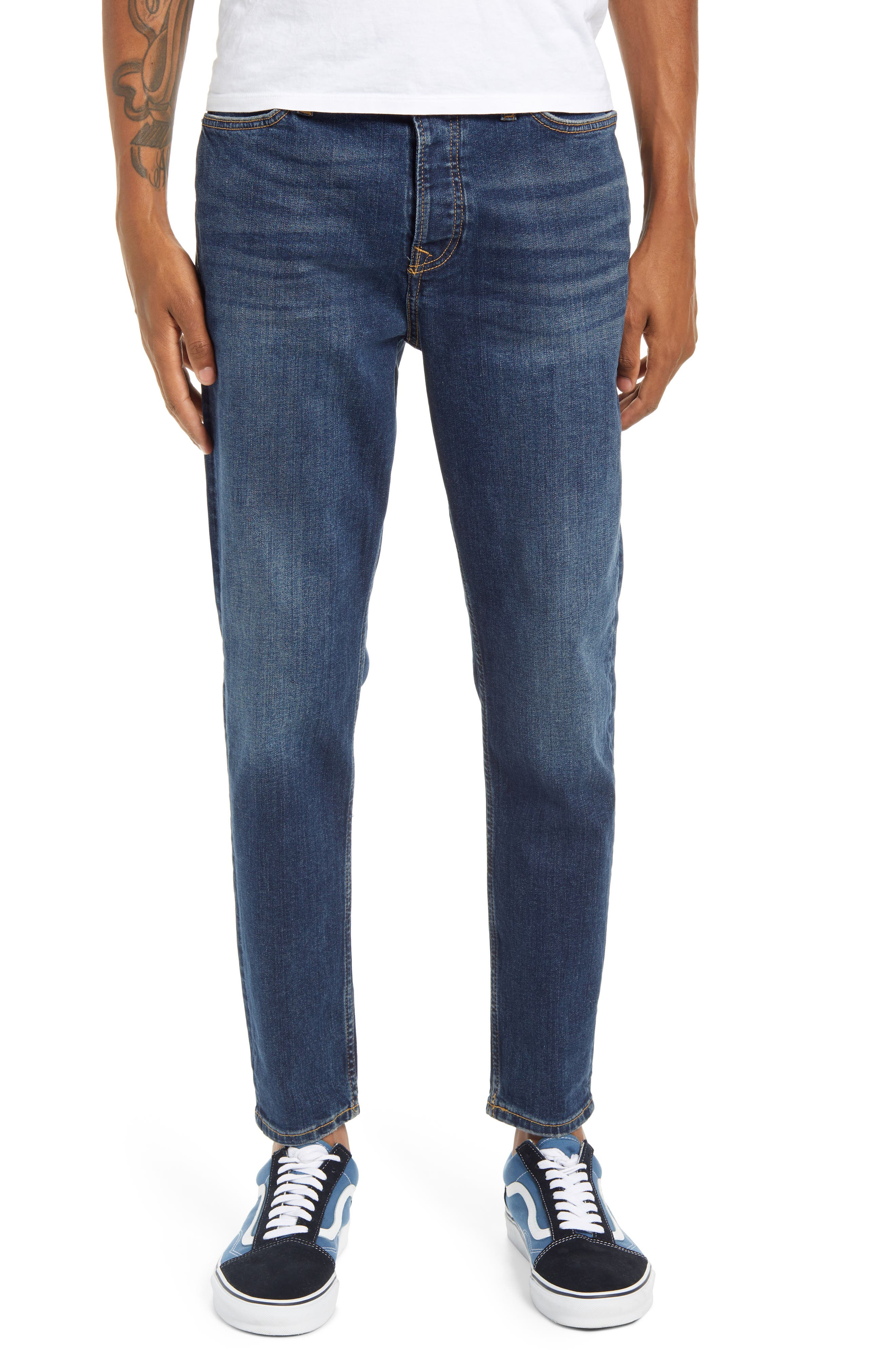 Tapered, straight legs define these faded blue jeans that are calling out for the weekend. Style Name: Topman Carrot Tapered Jeans. Style Number: 6094513. Available in stores.