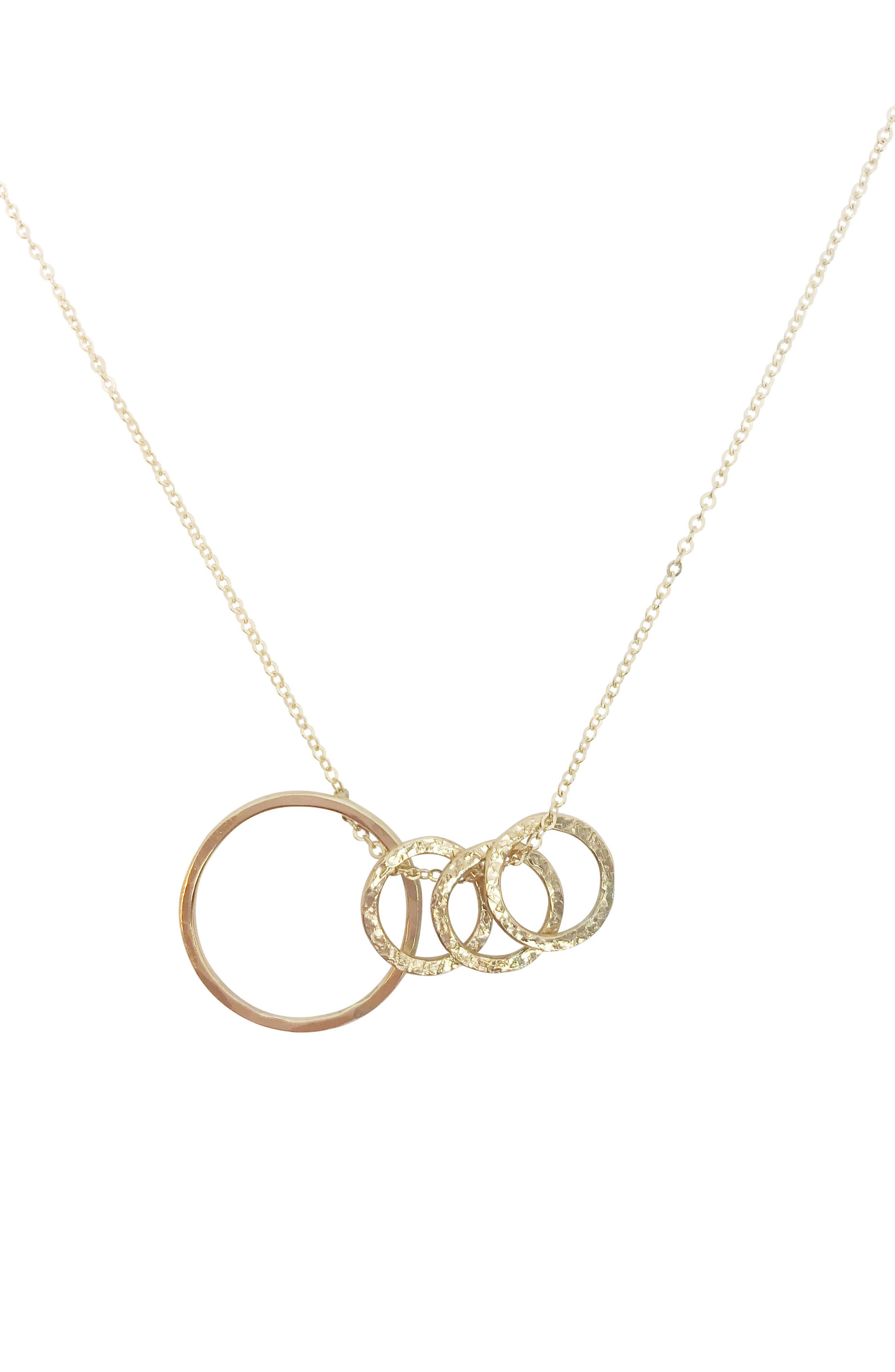 A necklace symbolizing one of life\\\'s most precious bonds features a large, hand-hammered circle interlocked with a trio of smaller circles. Style Name: Nashelle Identity Mama & Child 4-Hoop Necklace. Style Number: 5872647. Available in stores.