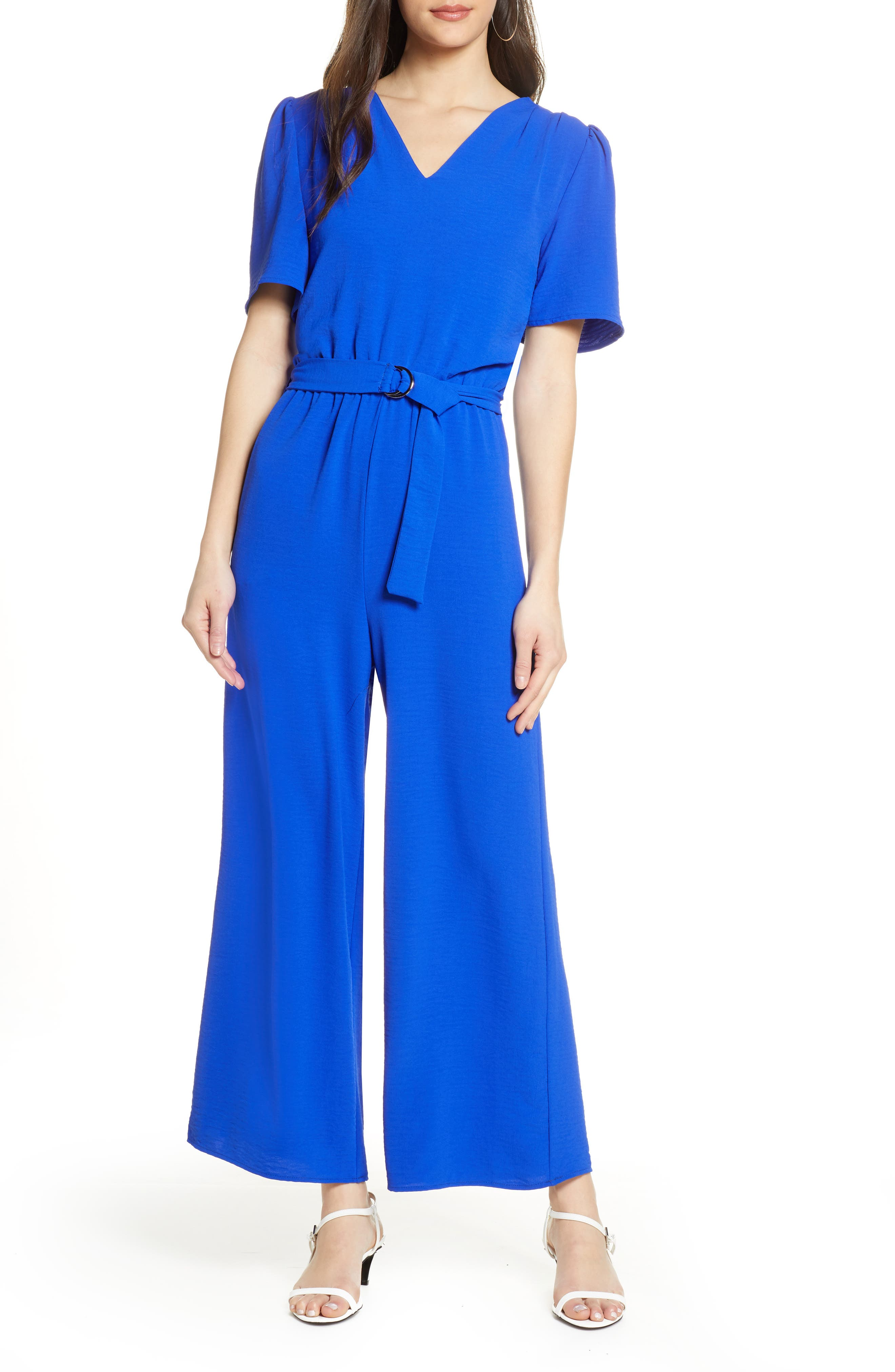 Bold color defines this flowy jumpsuit featuring puffed shoulders and a V-neck countered by cropped wide legs. Style Name: Fraiche By J Wide Leg Jumpsuit. Style Number: 5994769. Available in stores.