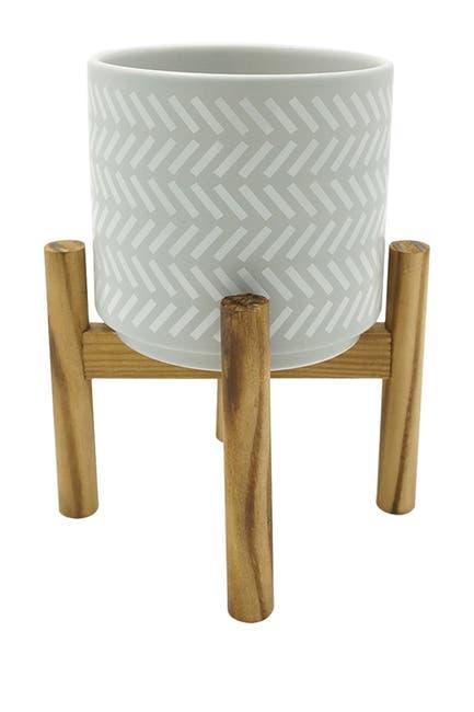 Image of Drew Derose Designs Patterned Ceramic Planter on Wooden Stand