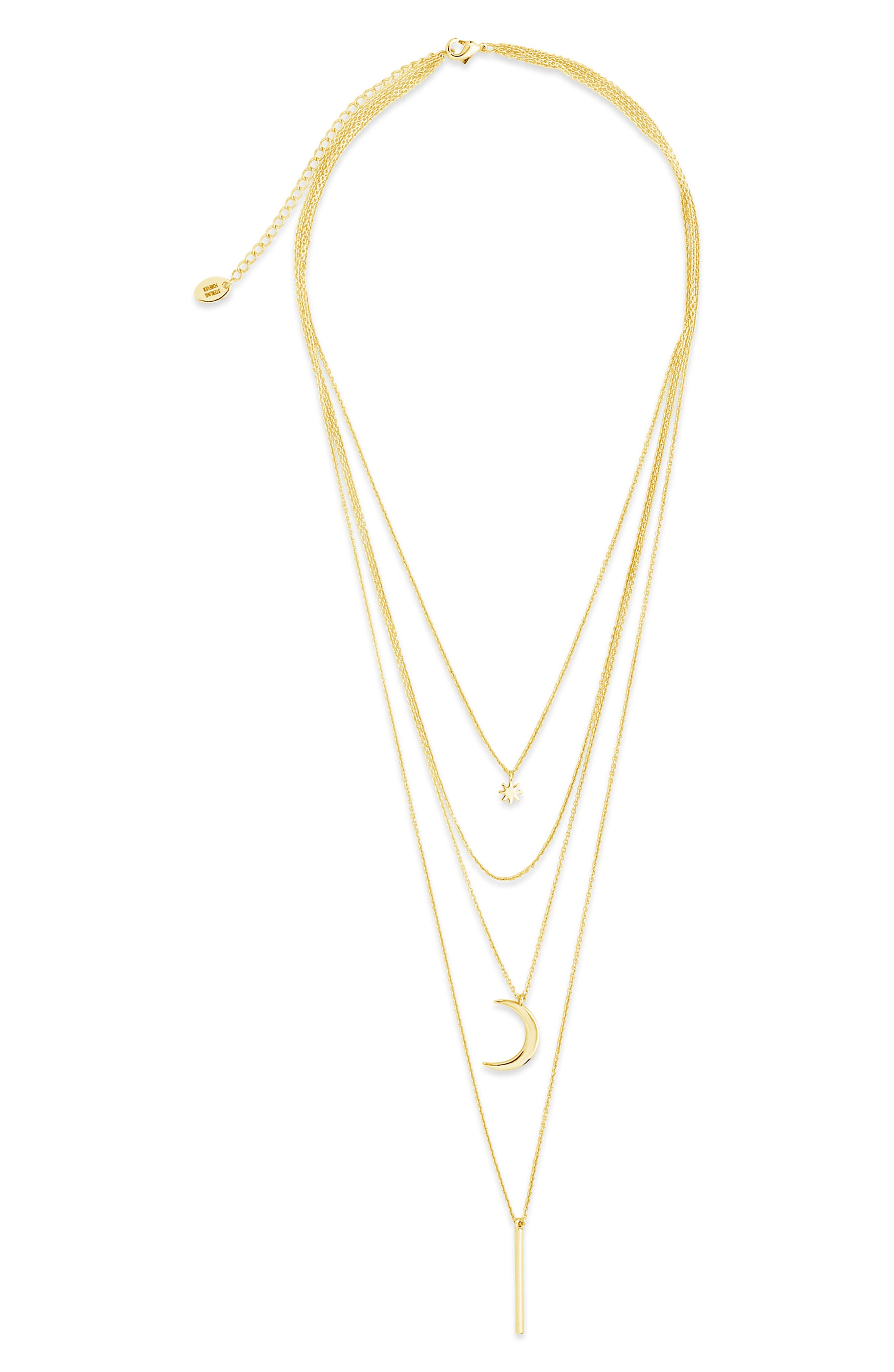 Dainty pendants anchor the delicate chains of a trend-smart multilayered necklace plated in gleaming 14-karat gold. Style Name: Sterling Forever Layered Pendant Necklace. Style Number: 5804355. Available in stores.