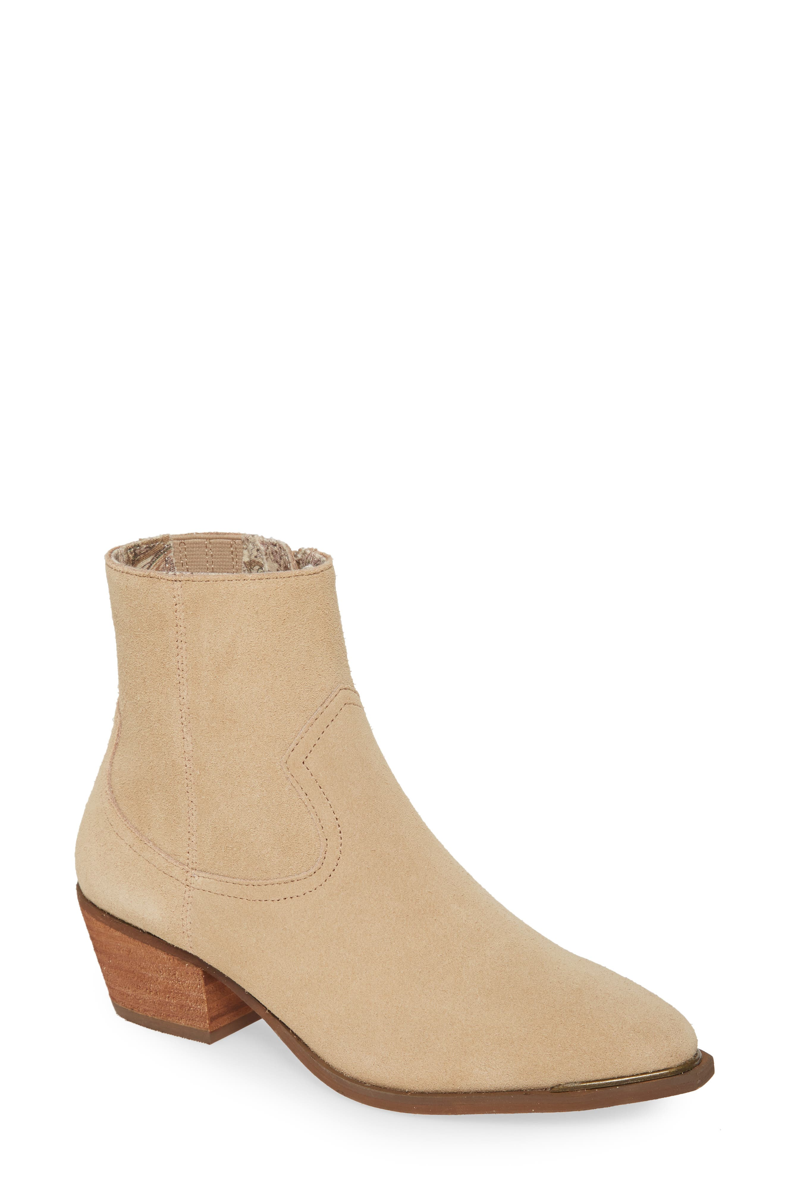 An antique-finish rand at the toe adds subtle embellishment to a minimalist Western-inspired bootie styled with concealed goring in the shaft for an easy fit. Style Name: Band Of Gypsies Creed Bootie (Women). Style Number: 5894642. Available in stores.