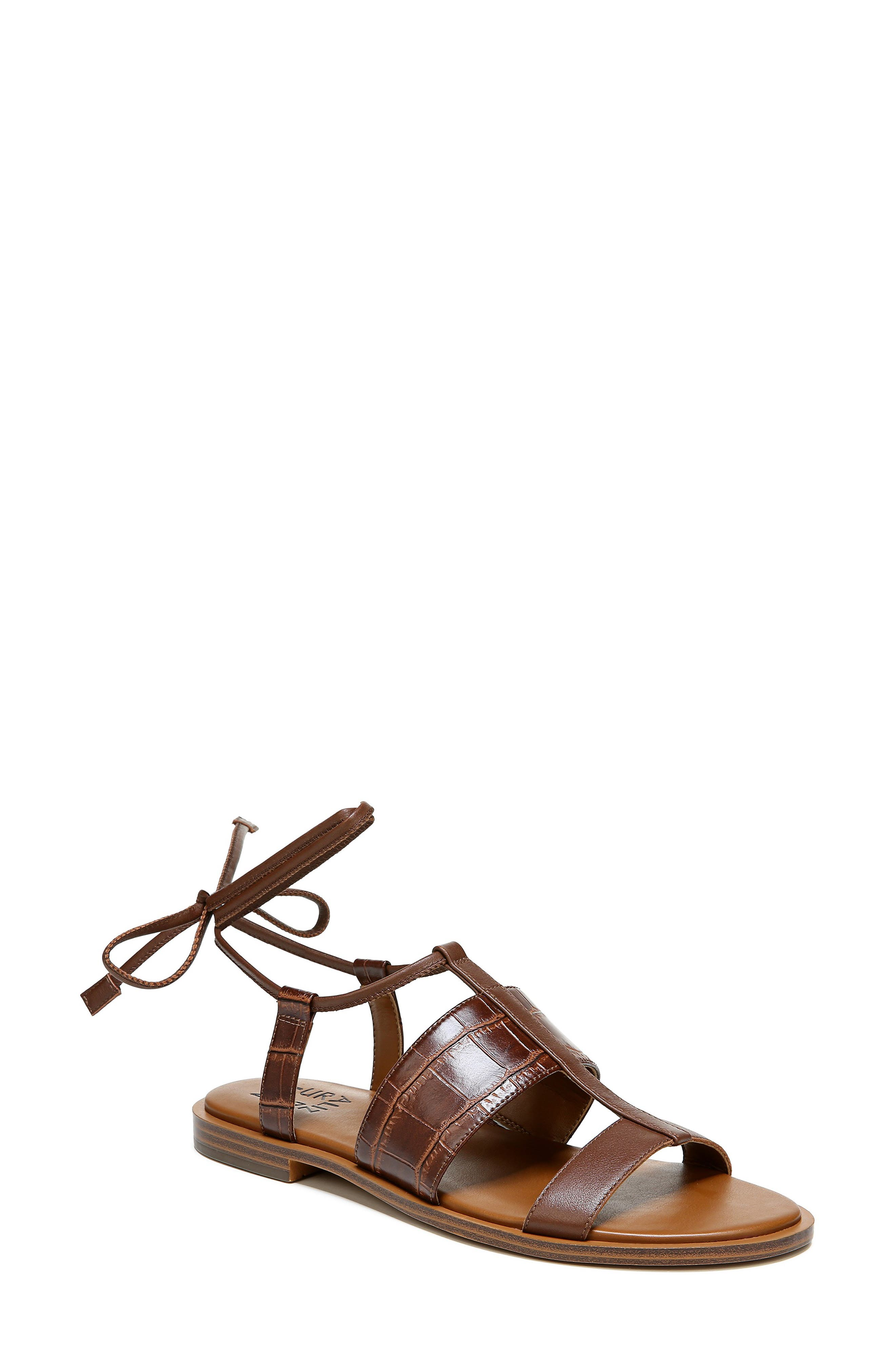 Slender, flattering ties wrap the ankle of this lightly gladiator-inspired sandal fashioned with a cushy dual-density footbed. Style Name: Naturalizer Fayee Sandal (Women). Style Number: 6015154. Available in stores.
