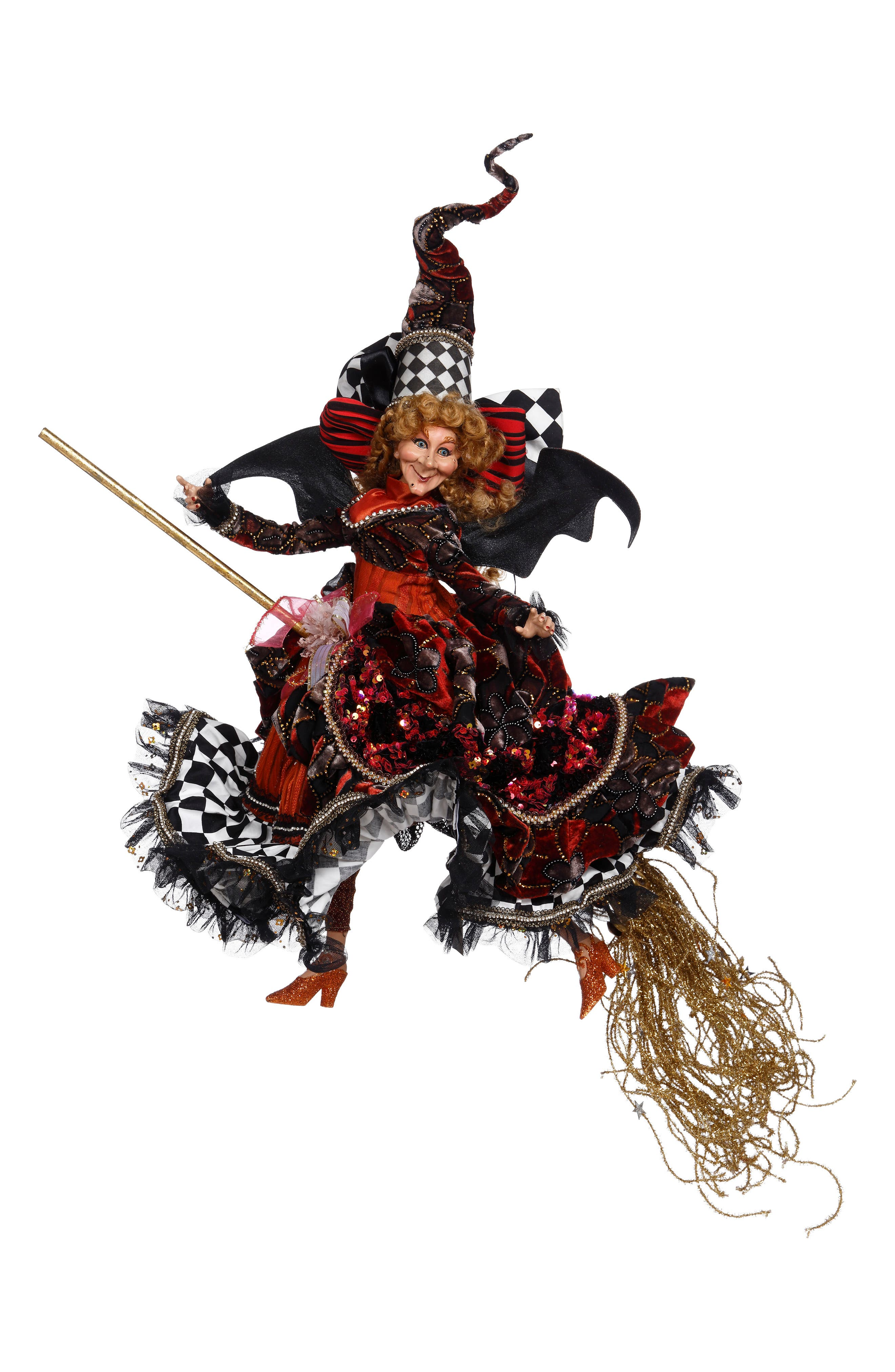 A gleeful witch decked out in ruffles, sequins and crystals is on her way to stir up some wicked good fun. Wearing a curly, pointed hat and perched on a glittery broom, this limited-edition decorative doll is a treat for any true Halloween lover and is so beautifully detailed that it\\\'s sure to become a future family heirloom. Style Name: Mark Roberts Flying Witch On A Mission Decoration. Style Number: 6070873. Available in stores.