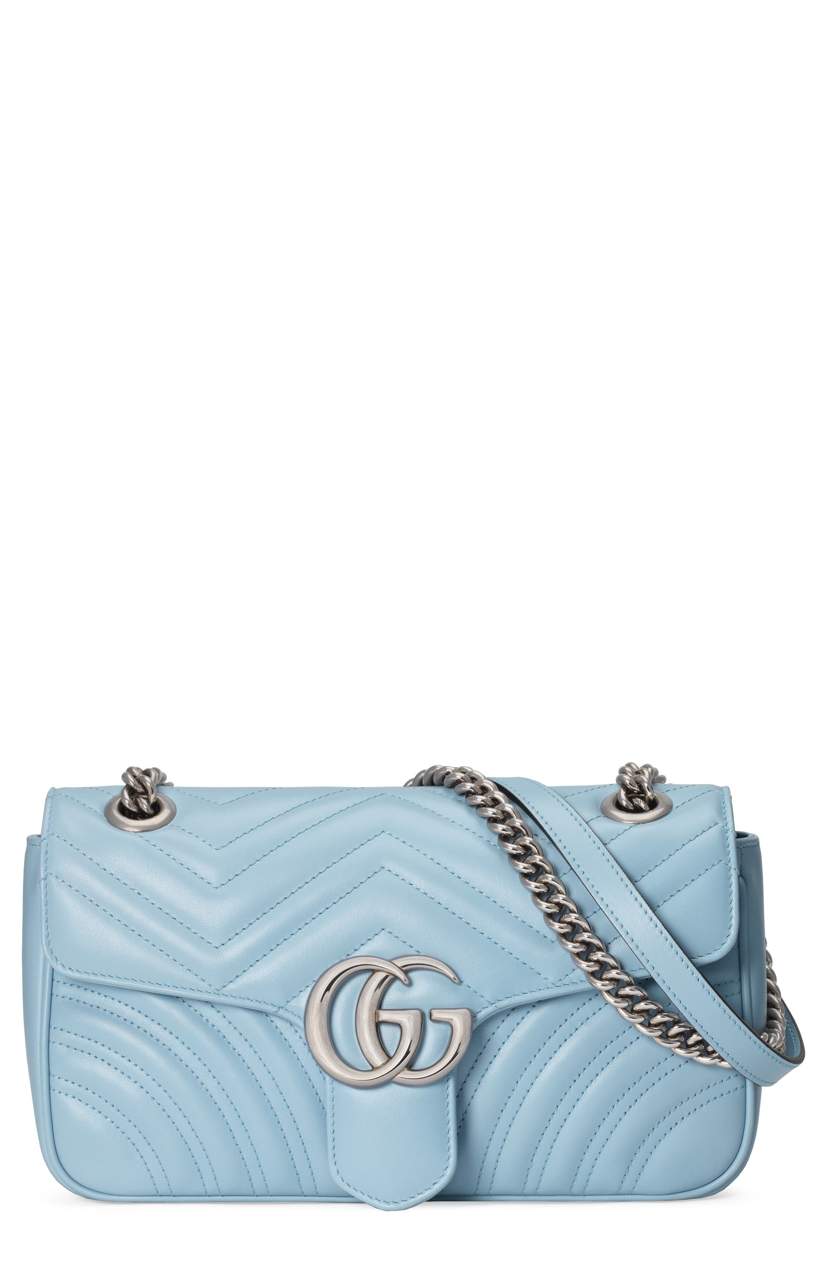 Gucci gives its Marmont bag a charming makeover with dreamy pastel color that plays up the silvertone double-G hardware and dimensional matelasse quilting. A sliding chain-and-leather strap can be doubled or extended as you prefer. Style Name: Gucci Small Gg 2.0 Matelasse Leather Shoulder Bag. Style Number: 6079616. Available in stores.