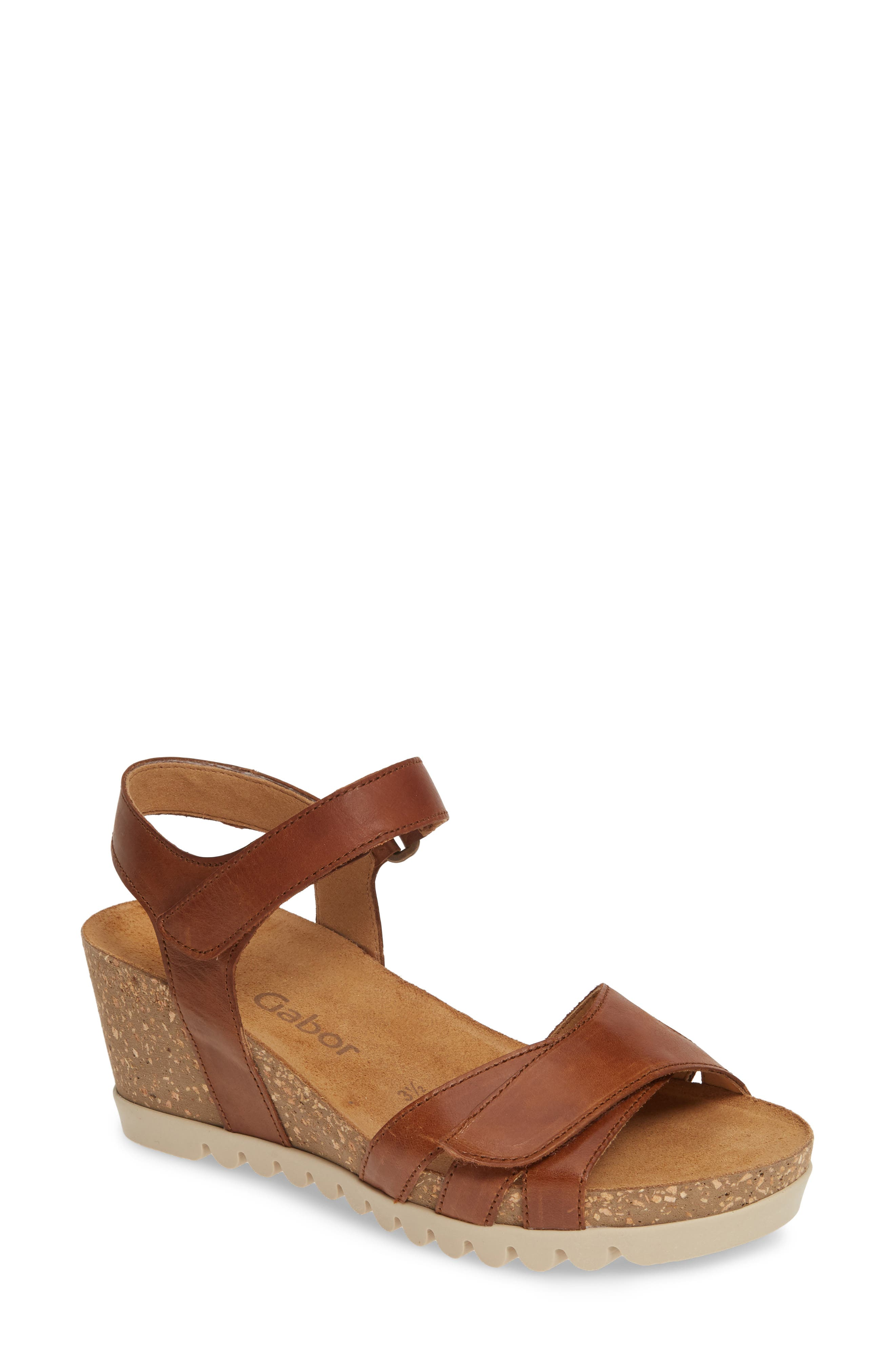 A cork wedge and platform bring summery height to a strappy sandal fitted with a cushy, arch-supporting footbed. Style Name: Gabor Wedge Sandal (Women). Style Number: 5822448. Available in stores.