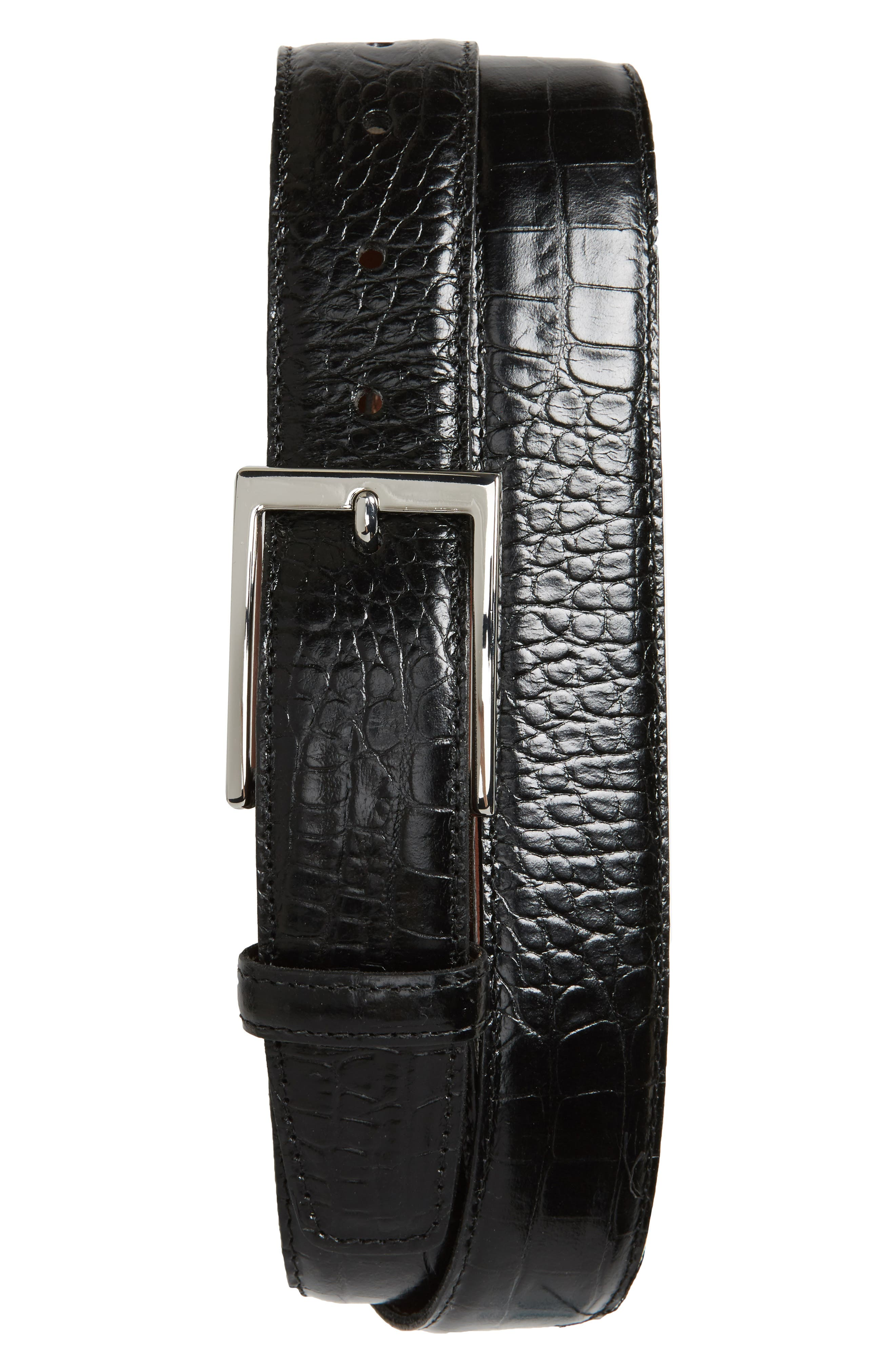Gator-skin embossing brings rich, distinctive detail to a leather belt crafted in the USA with two interchangeable rectangular buckles - one silvertone, one brass. Style Name: Torino Gator Grain Embossed Leather Belt. Style Number: 5596623. Available in stores.