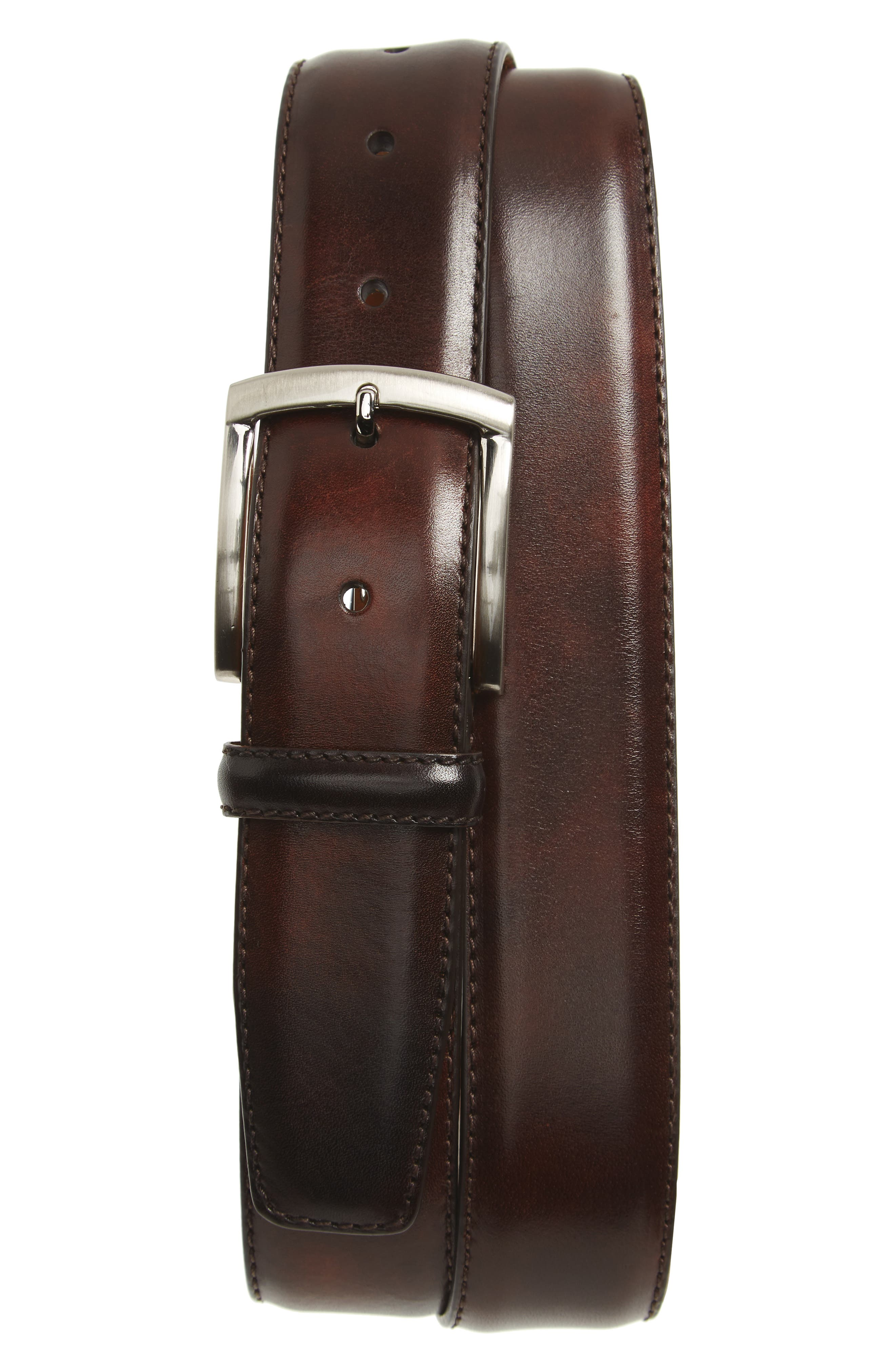 An elegant, richly hued belt is crafted in Spain from premium calfskin leather and secured with a brushed silvertone buckle for a modern touch. Style Name: Magnanni Tanner Leather Belt. Style Number: 5368199. Available in stores.