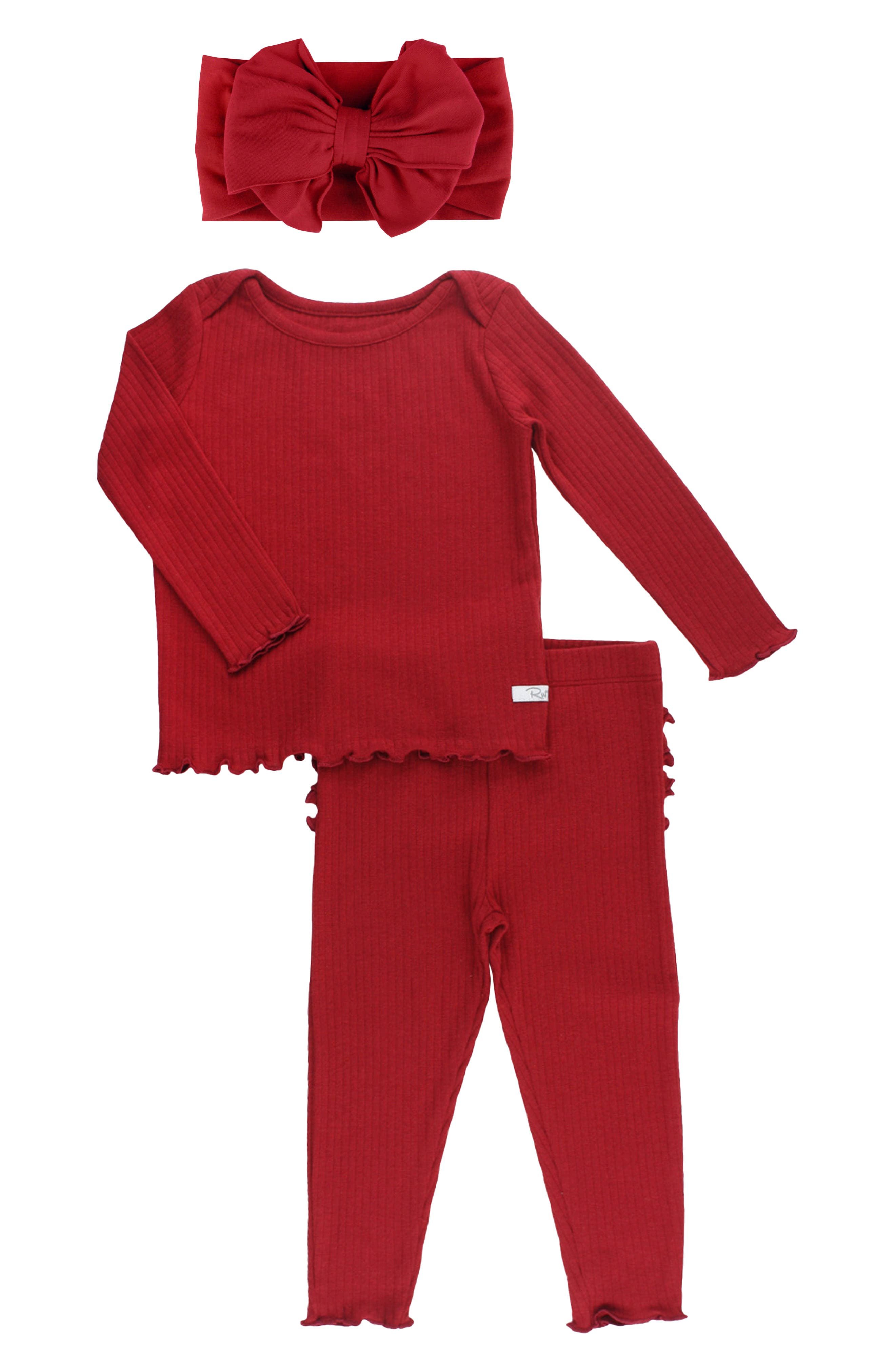 Send your little one sweetly off to sleep with these snug and beautifully hued two-piece ribbed pajamas finished with a coordinating head wrap. Lettuce edges and signature ruffles across the derriere overload these jammies with charm. Style Name: Rufflebutts Cranberry Fitted Two-Piece Pajamas & Head Wrap Set (Toddler, Little Girl & Big Girl). Style Number: 6136049. Available in stores.