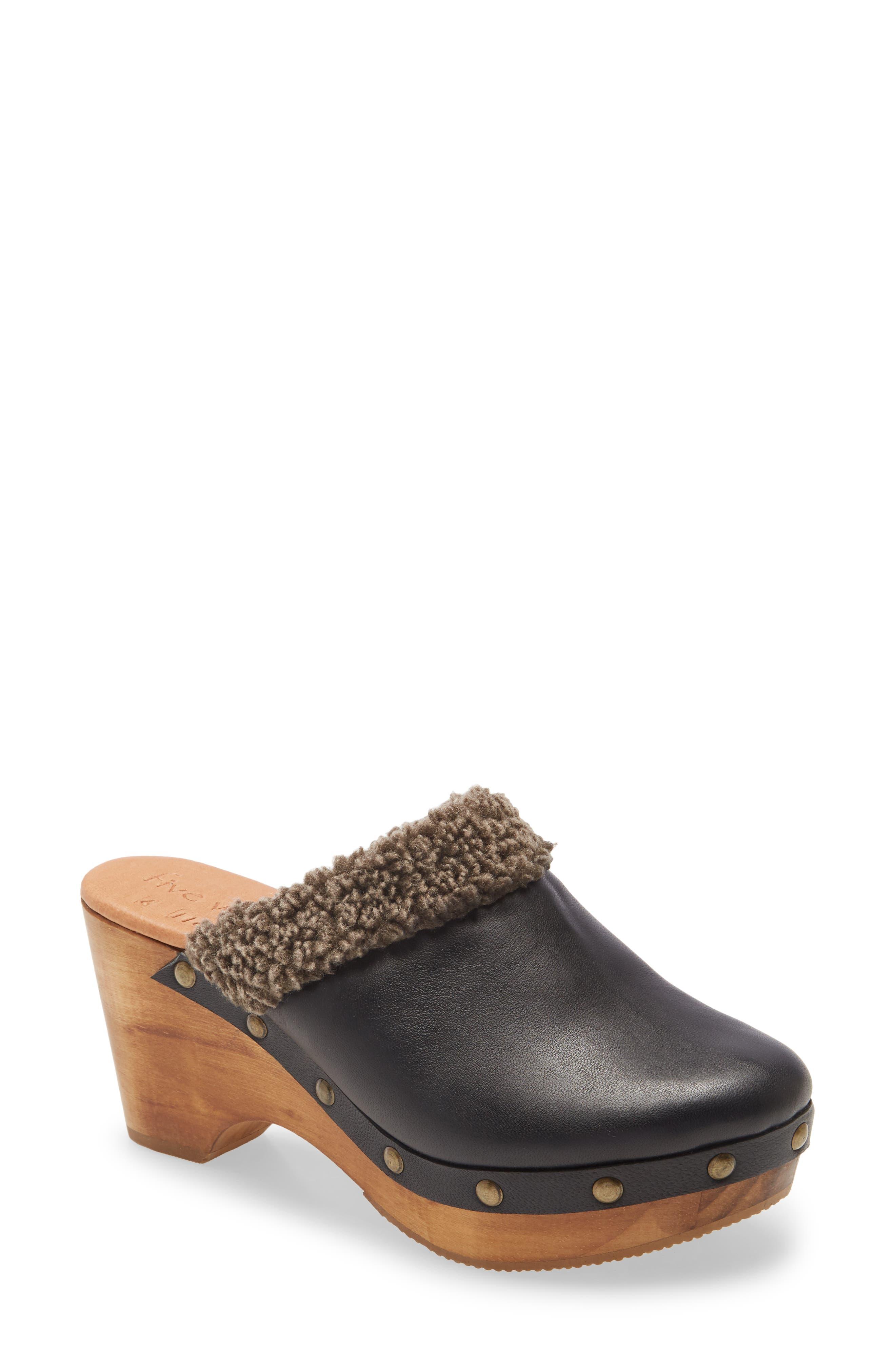 A curvy platform and heel carved from a single piece of wood elevate the vintage aesthetic of a studded clog in rich leather with a plush faux-fur lining. This style is part of the Five Worlds by Cordani collection, which was inspired by the ancient Aztecs and the Mexican landscape. Style Name: Cordani Zorba 2 Clog (Women). Style Number: 6102536. Available in stores.