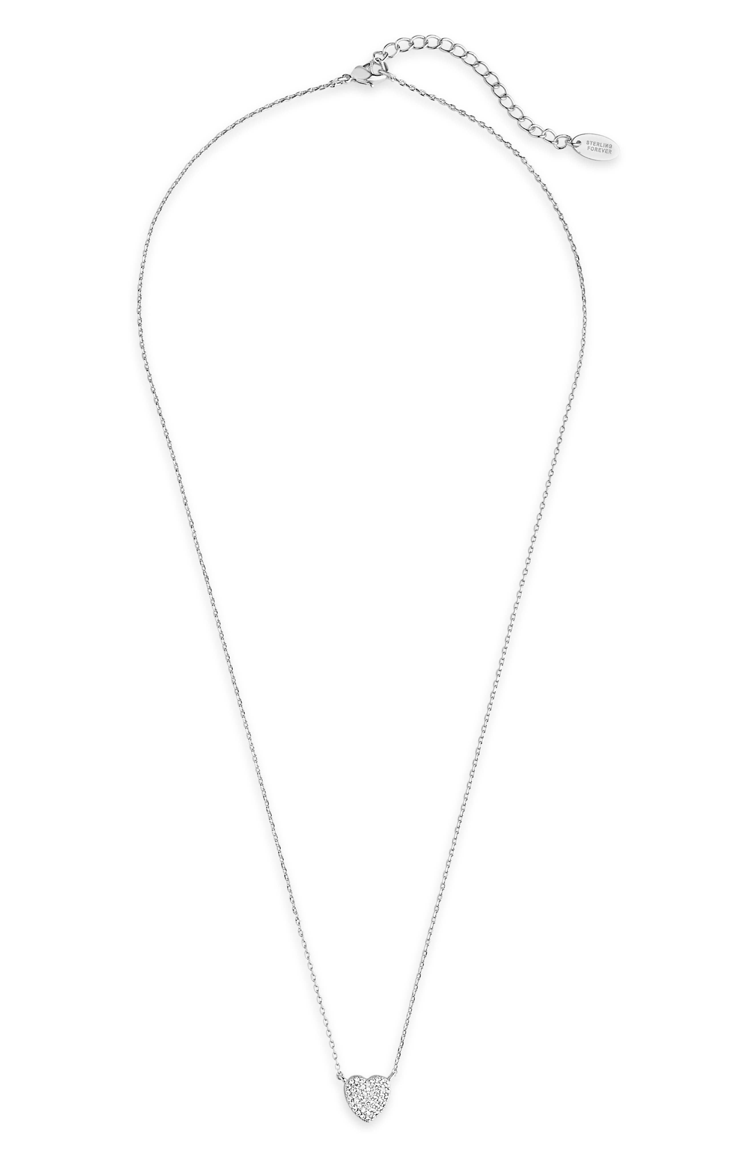 Cubic zirconia twinkle inside the heart pendant suspended from an elegant and dainty chain necklace. Style Name: Sterling Forever Heart Pendant Necklace. Style Number: 6114368. Available in stores.