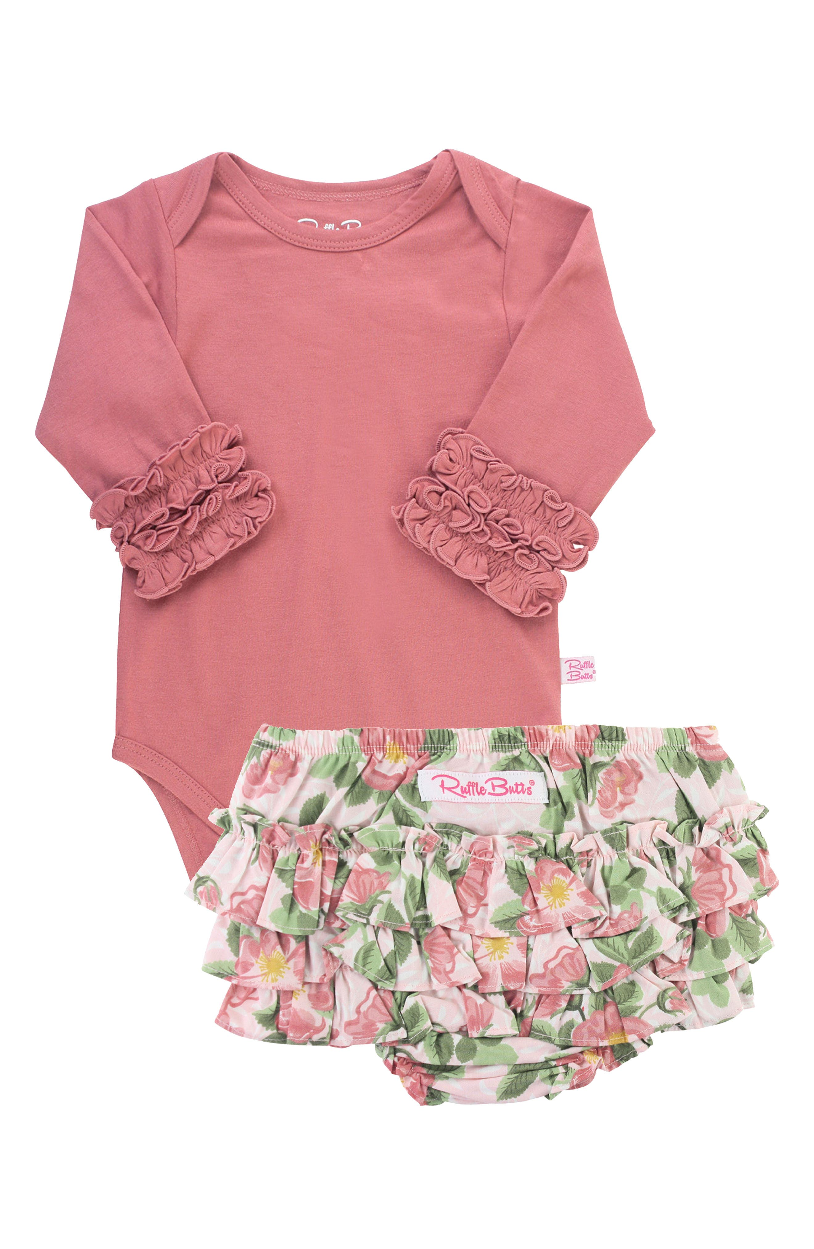 Fanciful frills trim this sweet set that includes a rosy bodysuit and bloom-print bloomers. Style Name: Rufflebutts Mauve Layering Set (Baby). Style Number: 6095645. Available in stores.