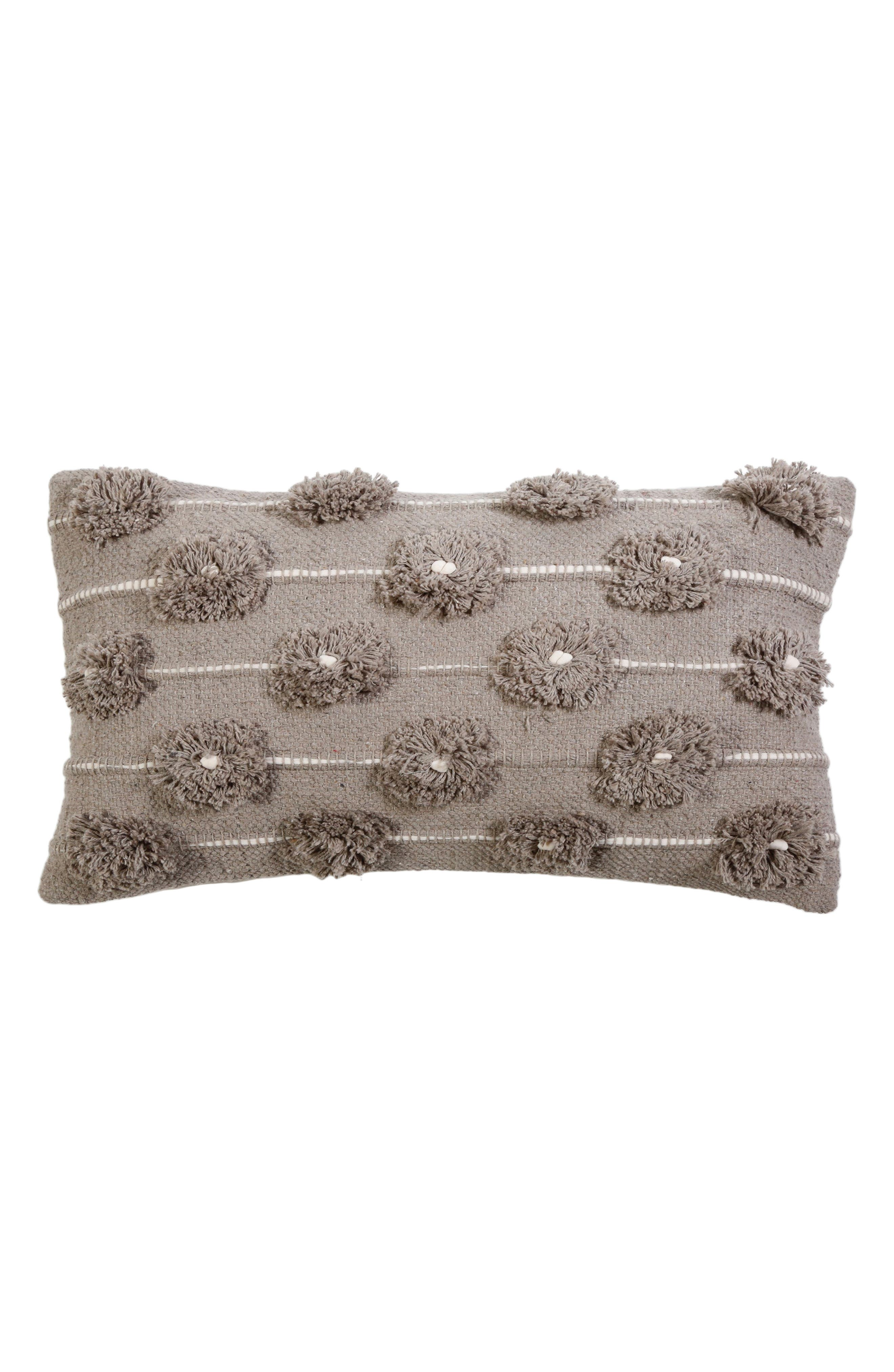 Plush poms and slender stripes lend tactile charm to a handwoven accent pillow done in soft neutral hues. Style Name: Pom Pom At Home Lola Accent Pillow. Style Number: 5857472. Available in stores.