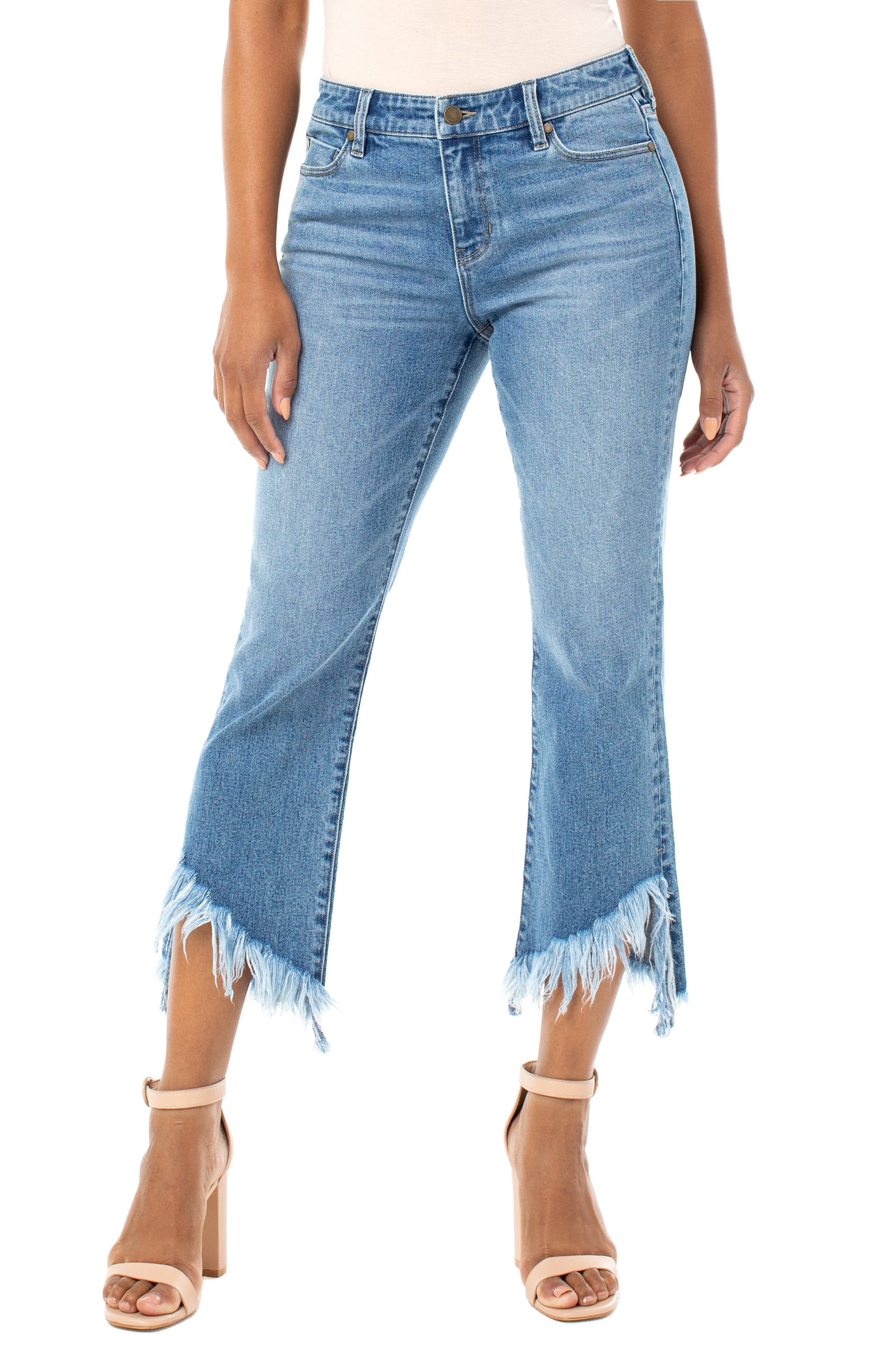 A just-right wash brings a preloved vibe to these show-off jeans done with a fringed, off-center hemline. Style Name: Liverpool High Waist Chewed Step Hem Crop Flare Jeans (Harding). Style Number: 5964927. Available in stores.
