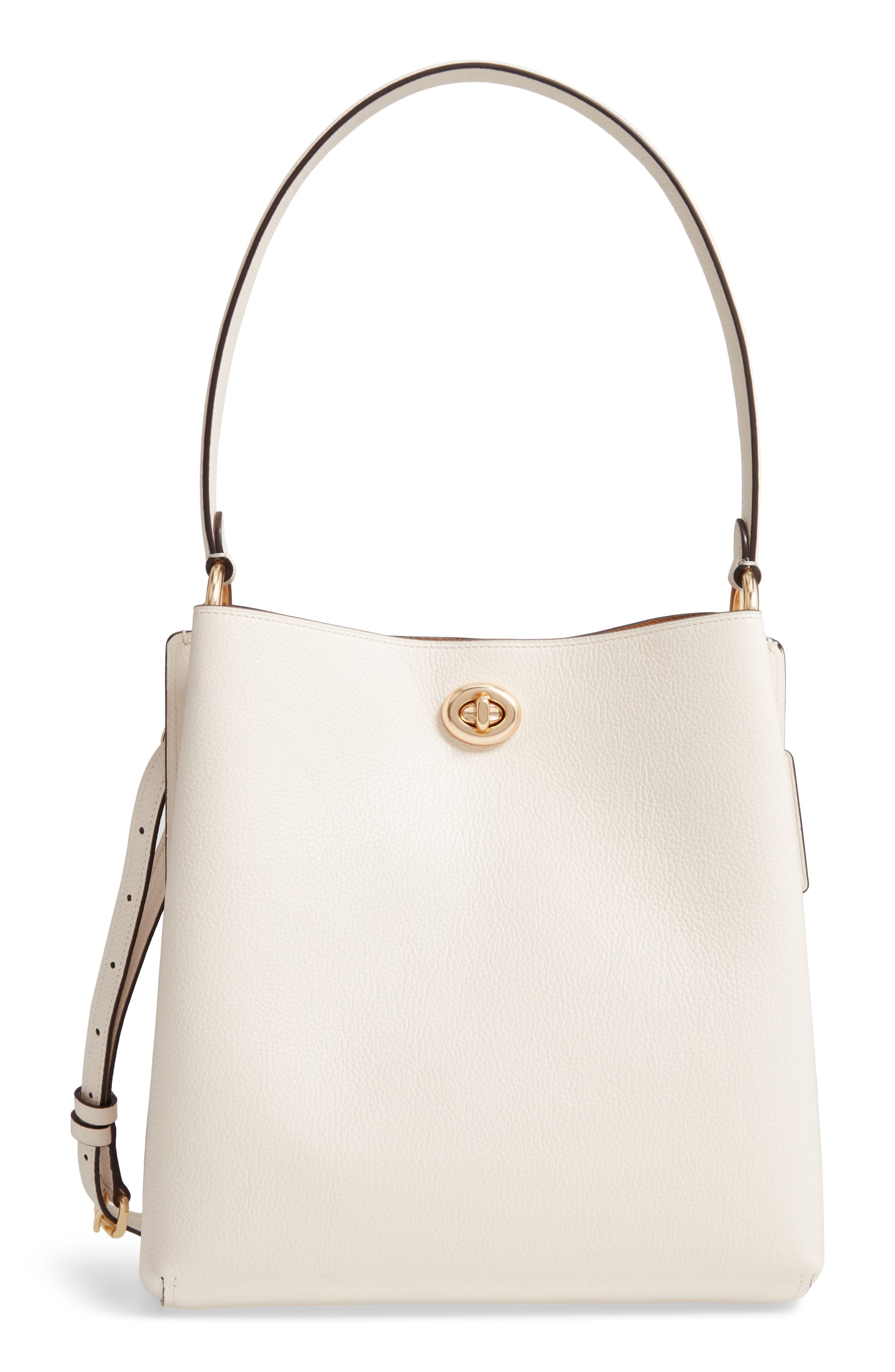 A clean-lined design beautifully plays up the pebbled leather of a structured bucket bag made with a divided interior and finished with signature hardware. A top handle and optional shoulder strap multiply your carrying options for the polished look. Style Name: Coach Charlie Leather Bucket Bag. Style Number: 5776046. Available in stores.