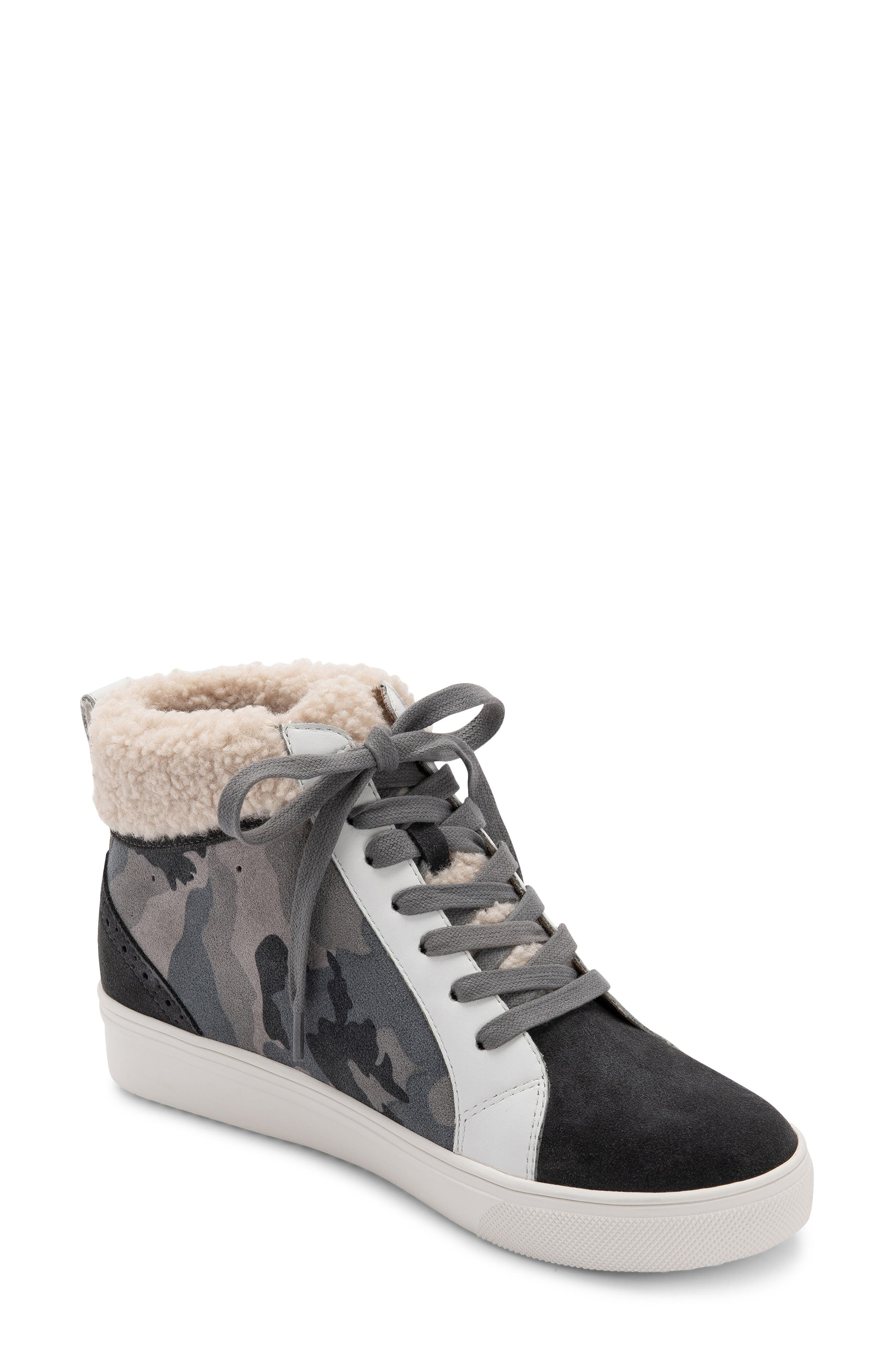 Plush faux fur brings wintry warmth to a street-chic lace-up sneaker with a mid-top profile grounded by a sporty rubber sole. Style Name: Blondo Gulia Waterproof Faux Fur Mid Sneaker. Style Number: 6068117. Available in stores.